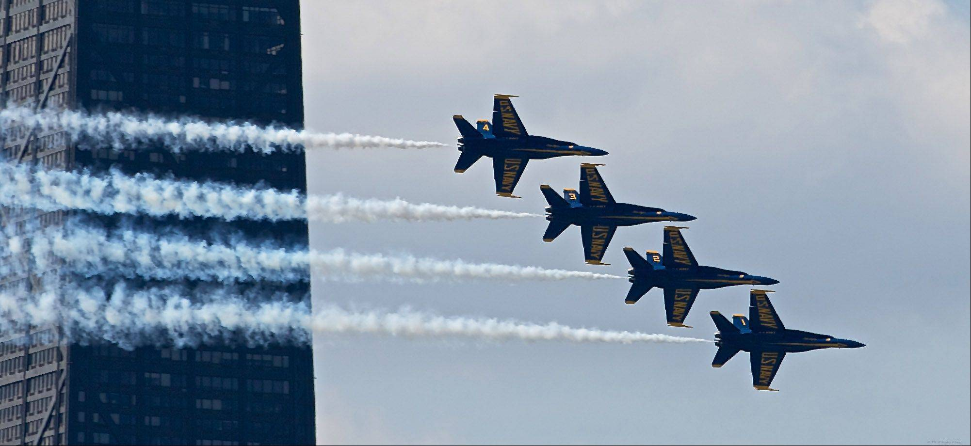 The Navy Blue Angels fly past the John Hancock building on August 18th at the 2012 Chicago Air & Water show.