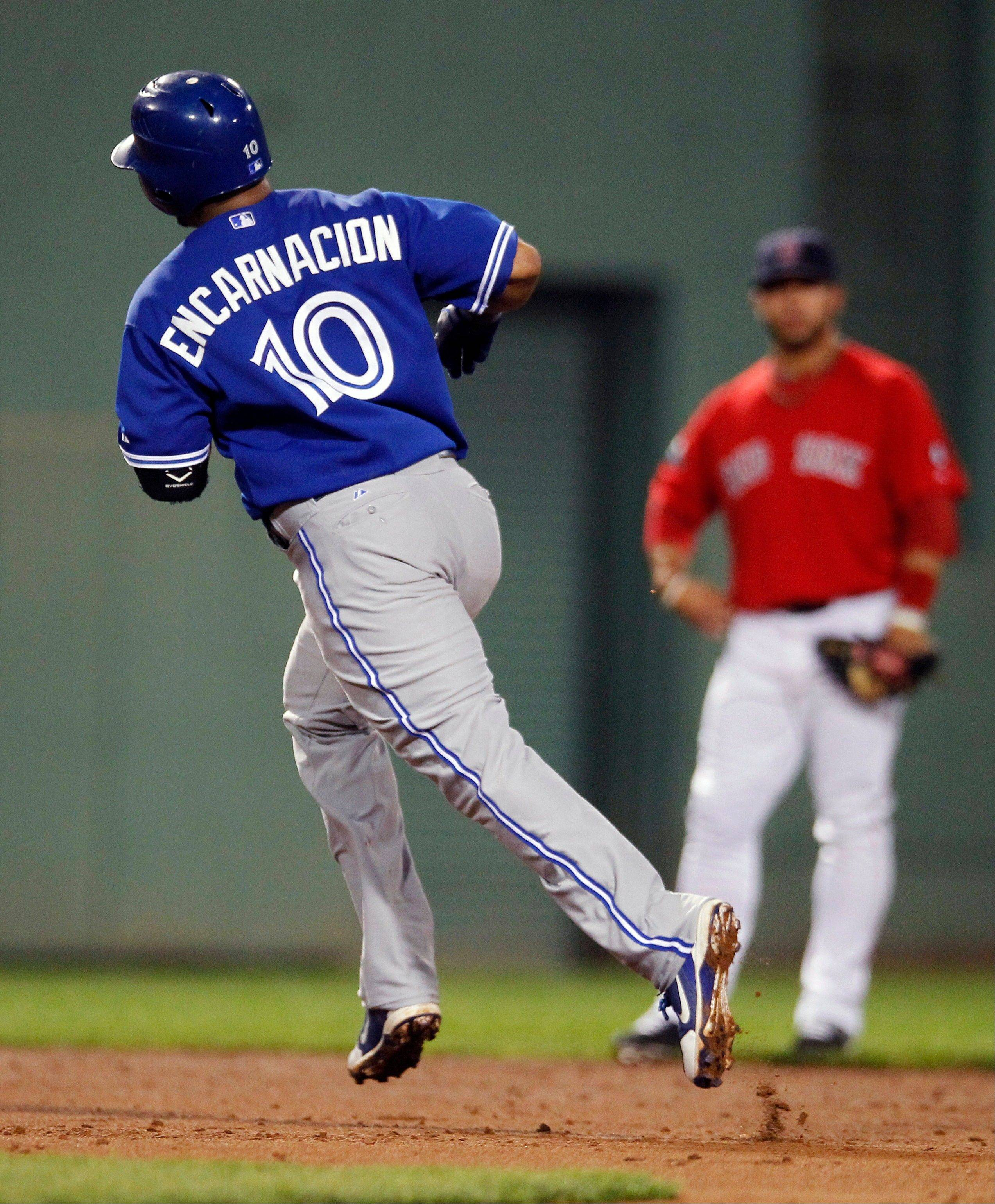 Toronto's Edwin Encarnacion rounds second base on a solo home run in the third inning Friday in Boston.