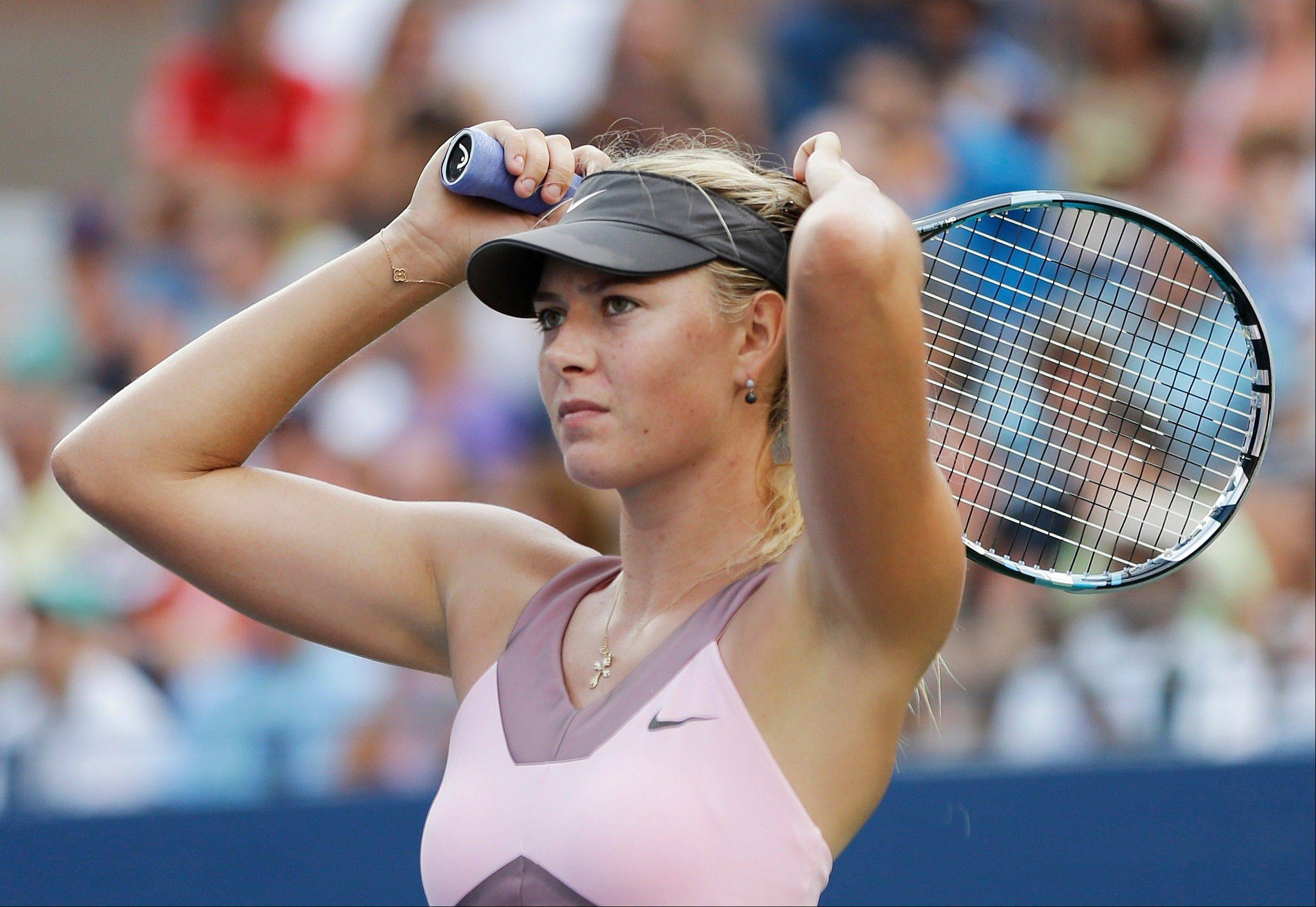 Maria Sharapova reacts after losing her match against Victoria Azarenka on Friday during the semifinals of the U.S. Open in New York.
