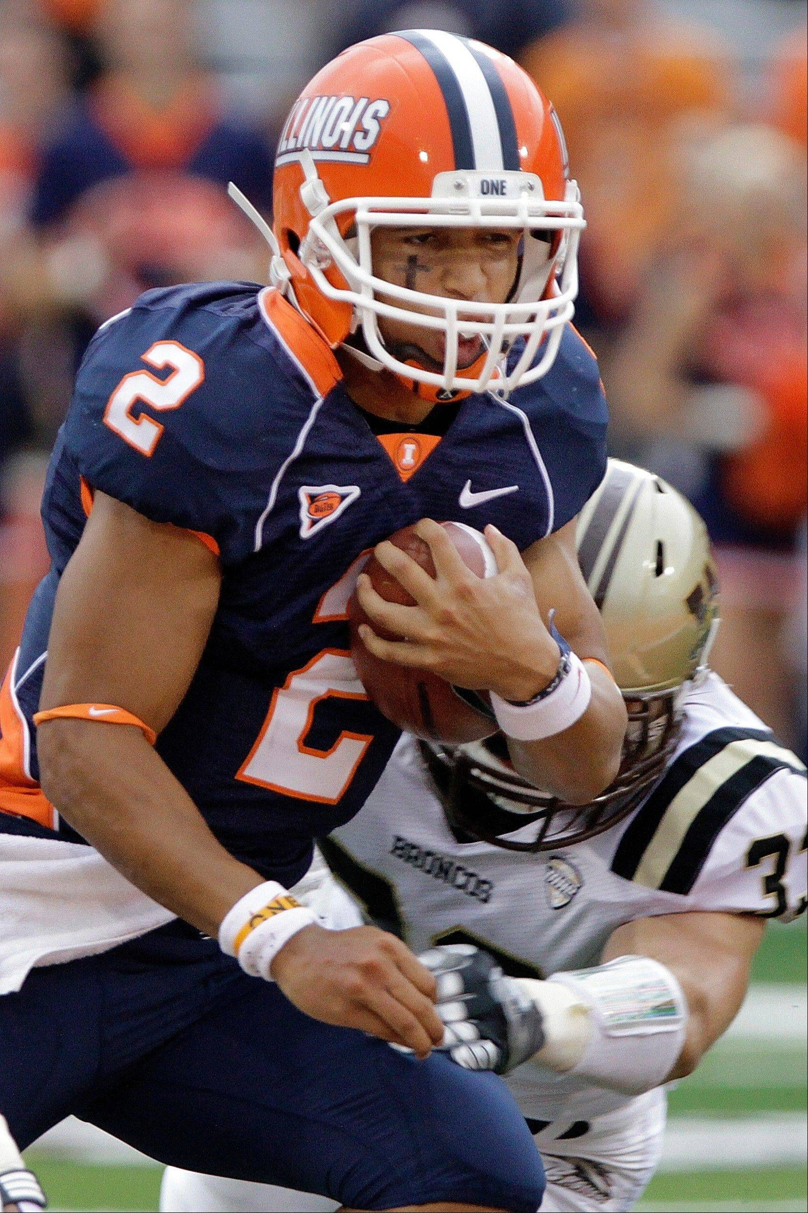 Illinois quarterback Nathan Scheelhaase runs with the ball last Saturday against Western Michigan in Champaign.