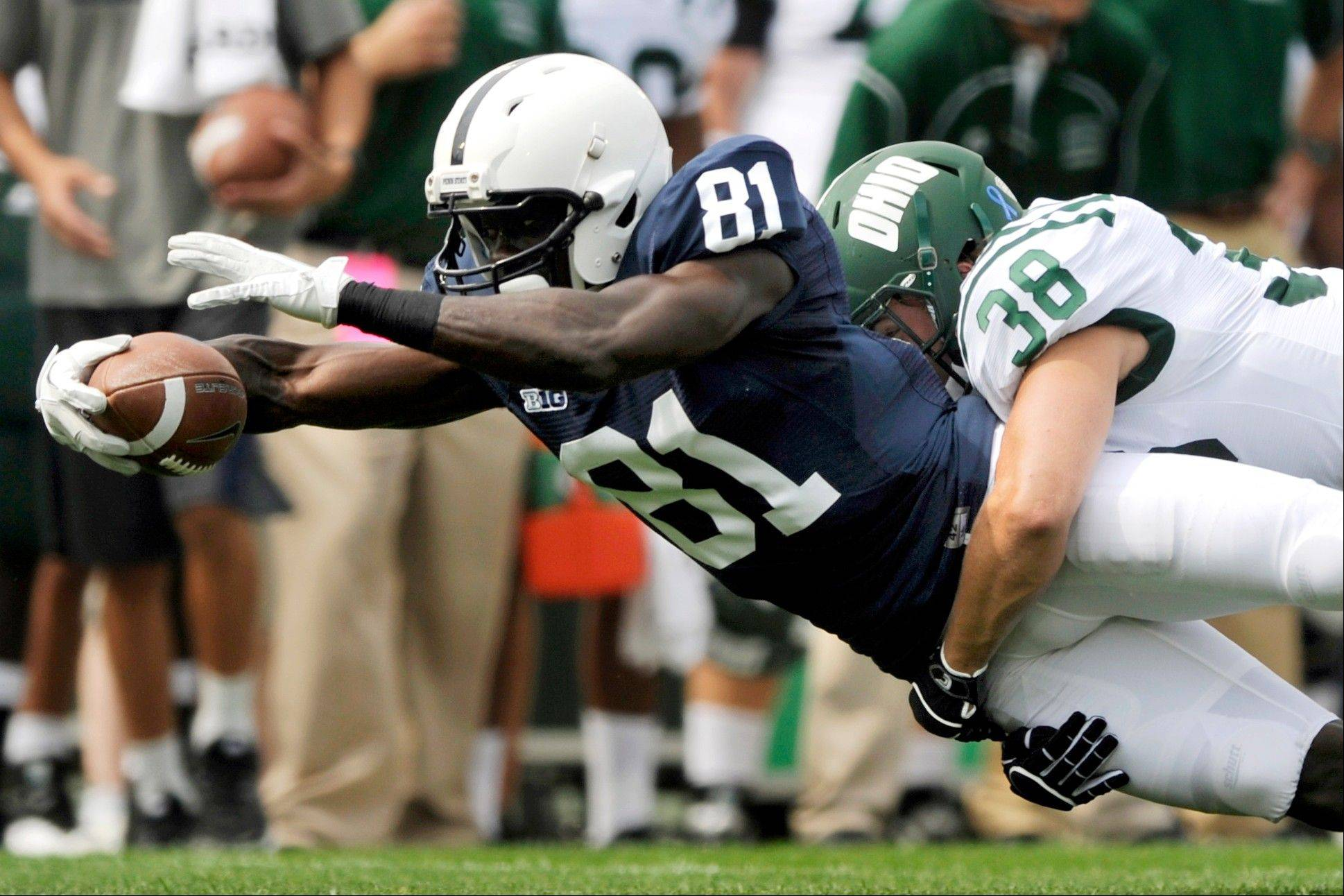 Penn State's Shawney Kersey is tackled by Ohio's Keith Moore during last Saturday's game in State College, Pa. Ohio won 24-14