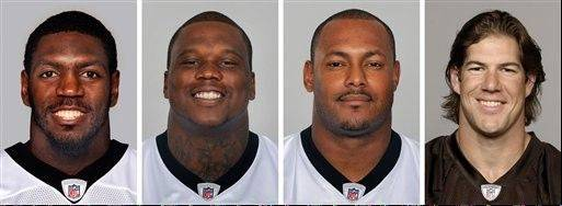 FILE - From left are NFL football players Jonathan Vilma, in 2011; Anthony Hargrove, in 2010; Will Smith, in 2011; and Scott Fujita, in 2011. The suspensions of four players in the NFL's bounty investigation have been lifted by a three-member appeals panel. The league reinstated those players a few minutes after Friday's, Sept. 7, 2012 ruling. While the ruling allows Saints linebacker Jonathan Vilma, Saints defensive end Will Smith, Cleveland linebacker Scott Fujita and free agent defensive lineman Anthony Hargrove to play immediately, it does not permanently void their suspensions