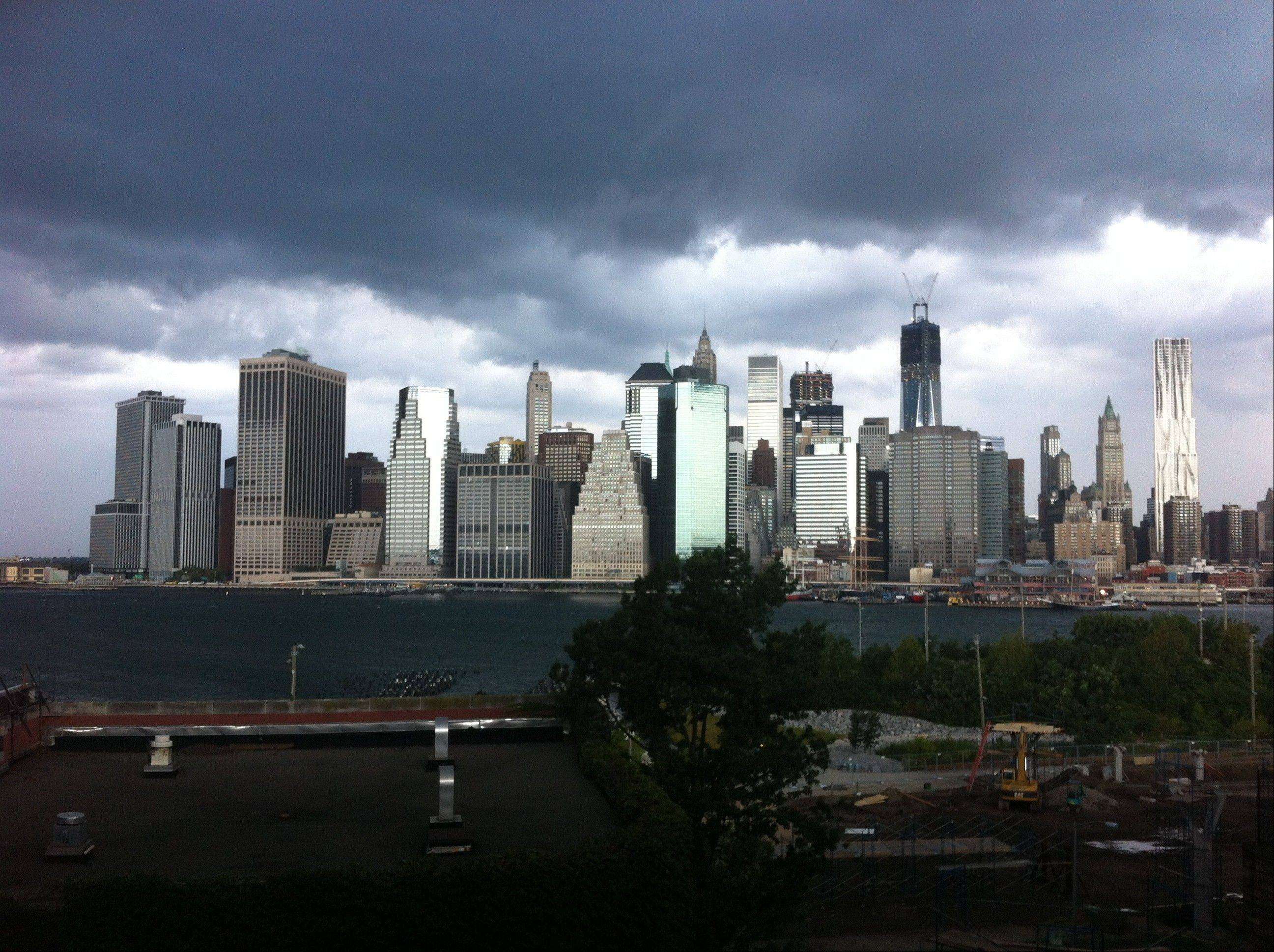 Dark clouds loom Saturday over the New York skyline.