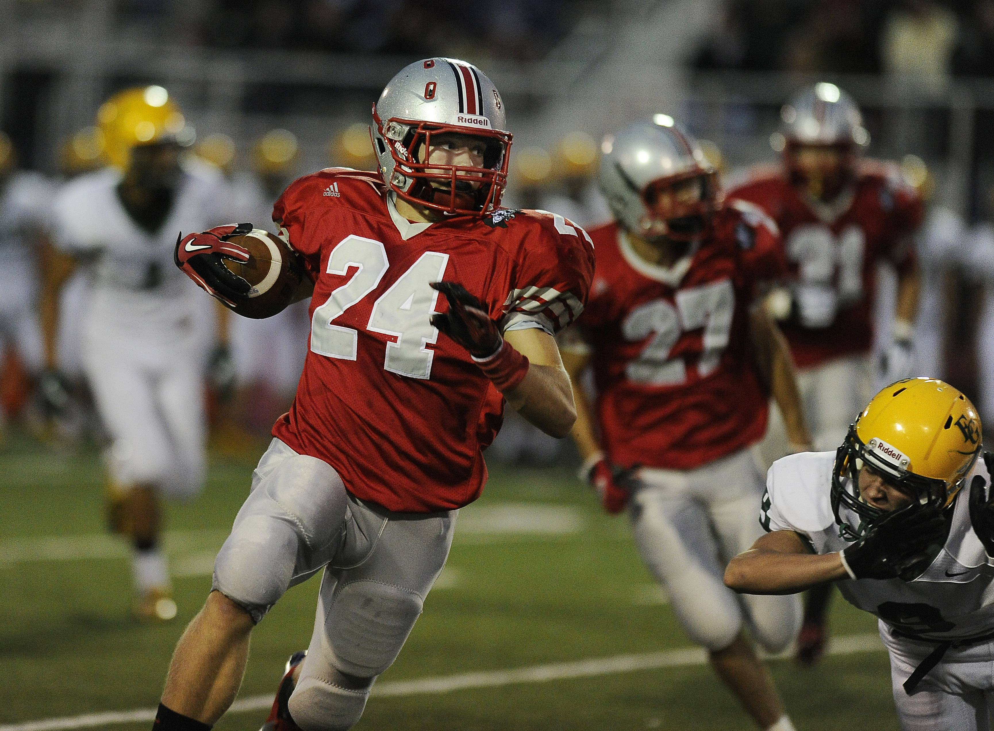 Palatine's Dan Riddle runs back an interception.