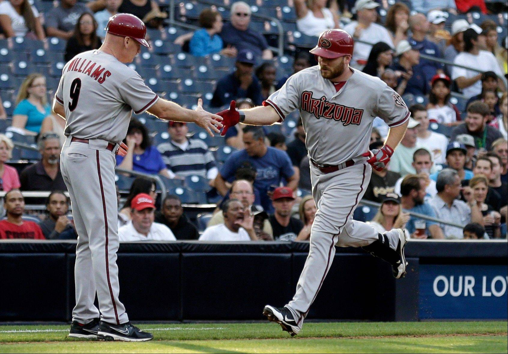 Arizona Diamondbacks Jason Kubel, right, is greeted third base coach Matt Williams after hitting a home run against the San Diego Padres during the third inning Saturday in San Diego.