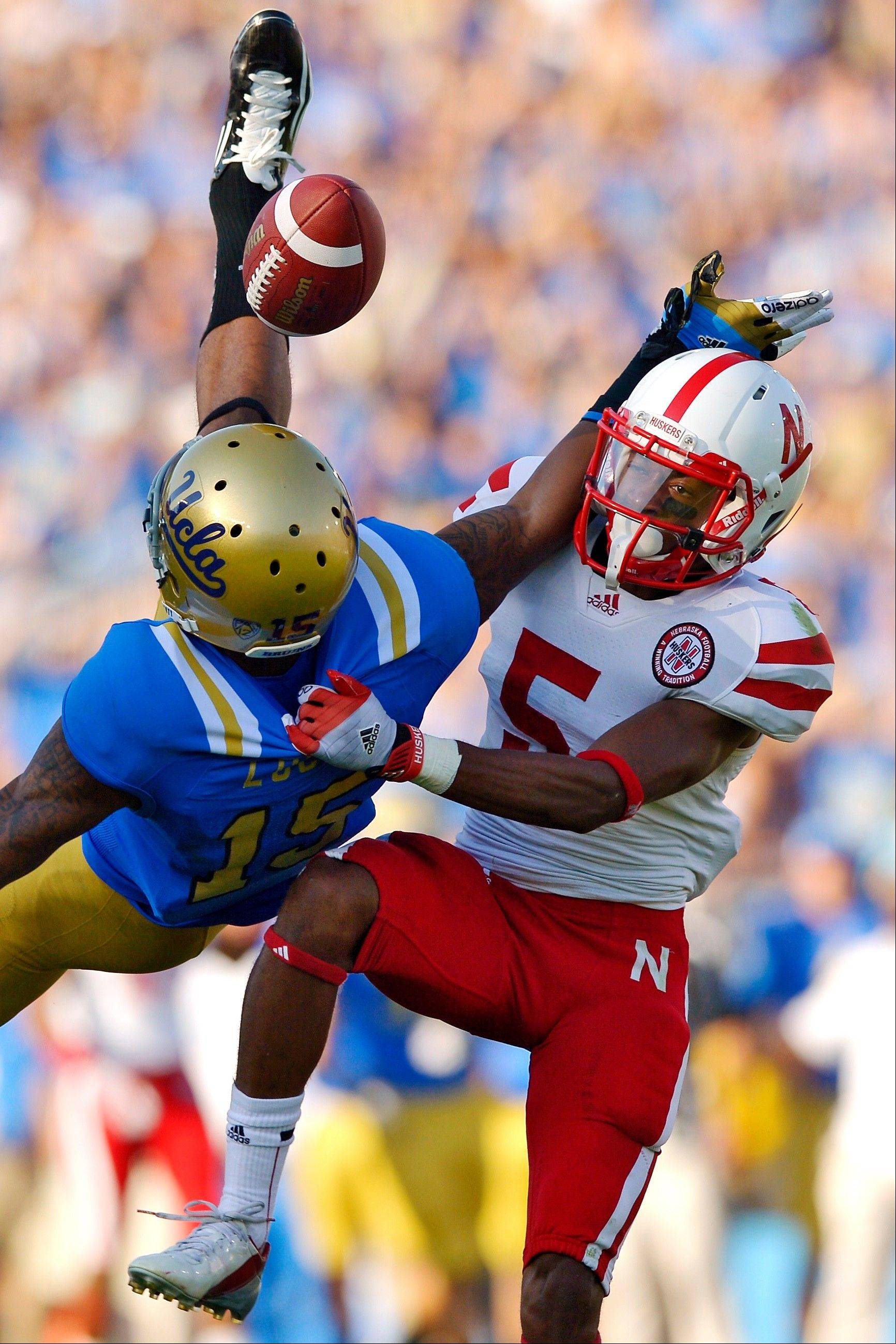 Nebraska cornerback Braylon Heard, right, breaks up a pass intended for UCLA wide receiver Devin Lucien during the first half Saturday in Pasadena, Calif.