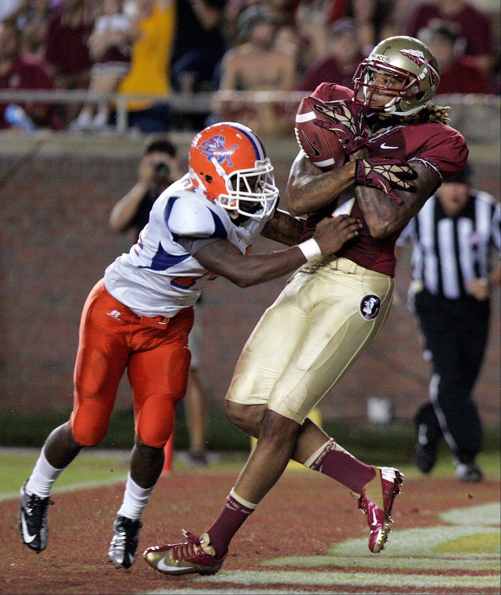 Florida State's Kevin Benjamin pulls in a touchdown pass past the defense of Savannah State's Wayne Johnson in the third quarter Saturday in Tallahassee, Fla.