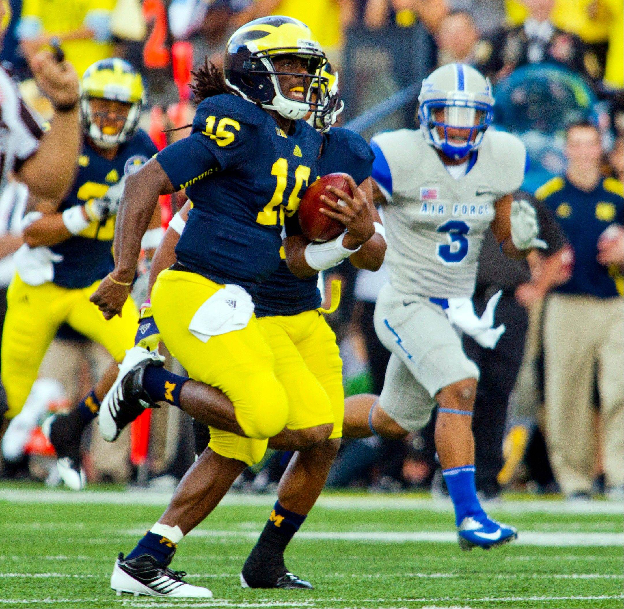 Michigan quarterback Denard Robinson rushes for a 79-yard touchdown Saturday against Air Force in Ann Arbor, Mich.