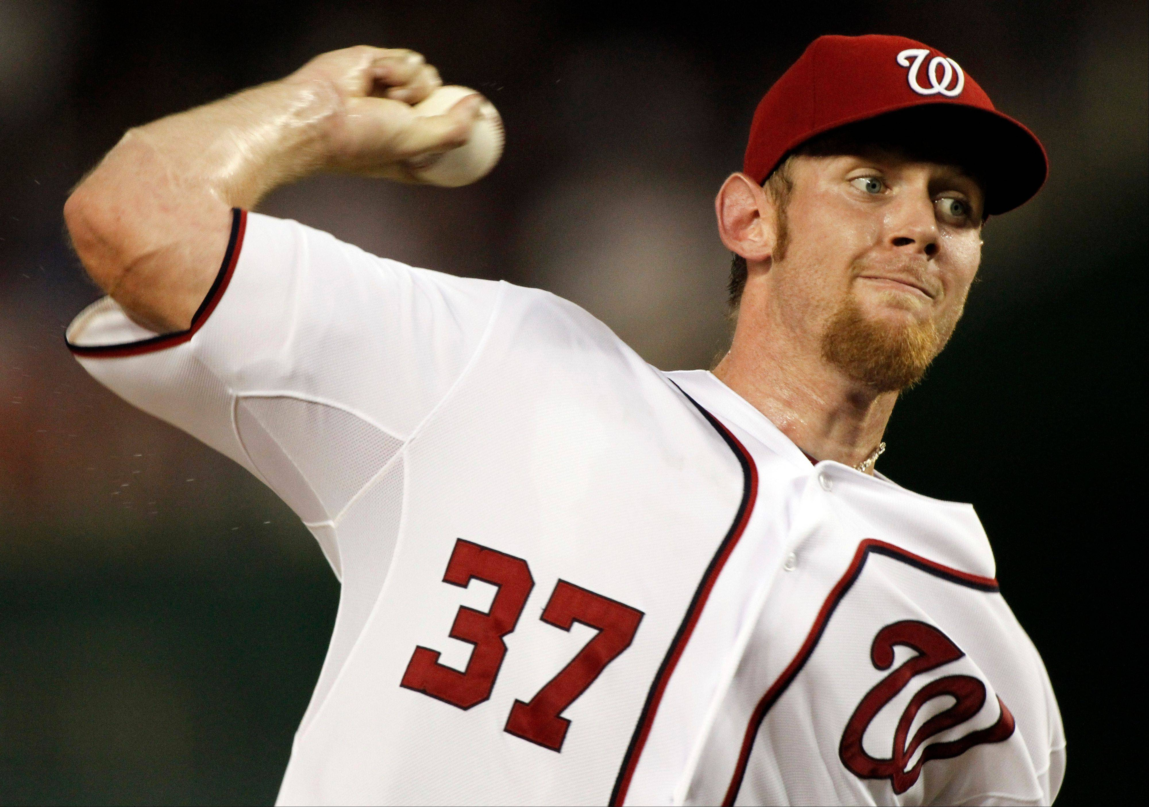 Washington Nationals starting pitcher Stephen Strasburg throws during the second inning Friday at home against the Miami Marlins.