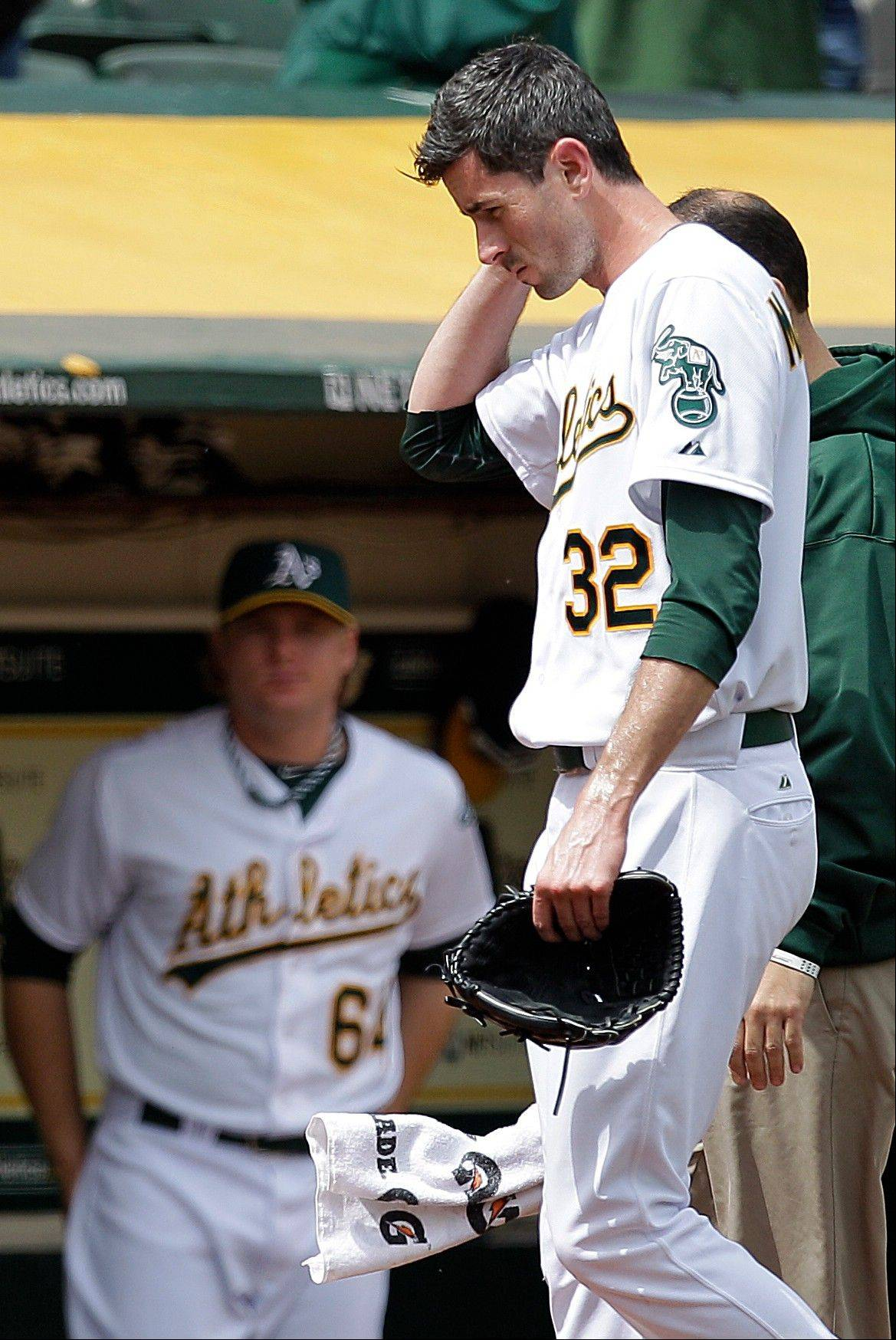 Oakland Athletics pitcher Brandon McCarthy leaves the game after being struck in the head on Wednesday.