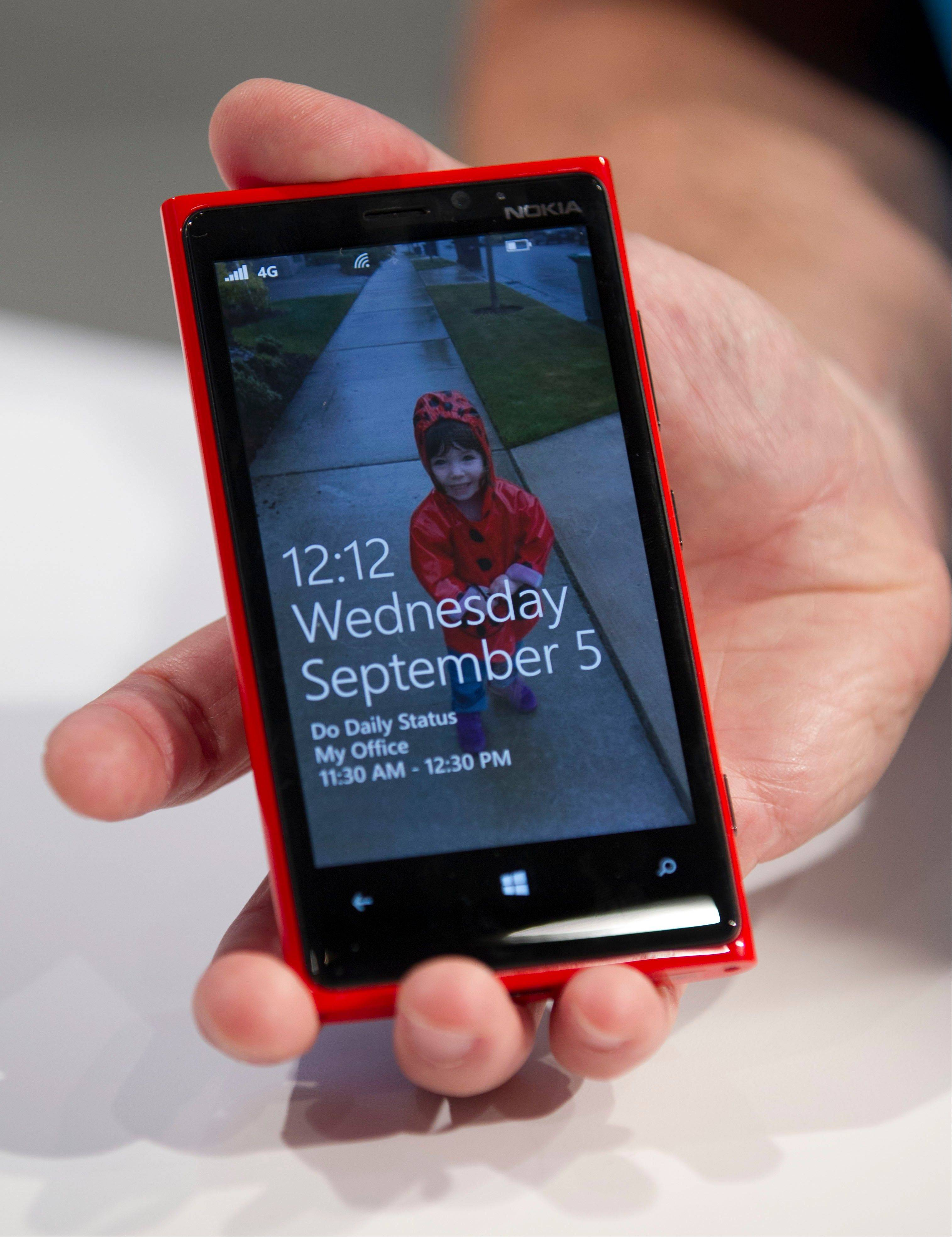 The new Nokia Lumia 920 is displayed during a news conference in New York, U.S., on Wednesday, Sept. 5, 2012. Nokia Oyj unveiled two smartphones using Microsoft Corp.'s new Windows Phone software, betting on the devices to win back sales lost to the iPhone and Android handset makers.