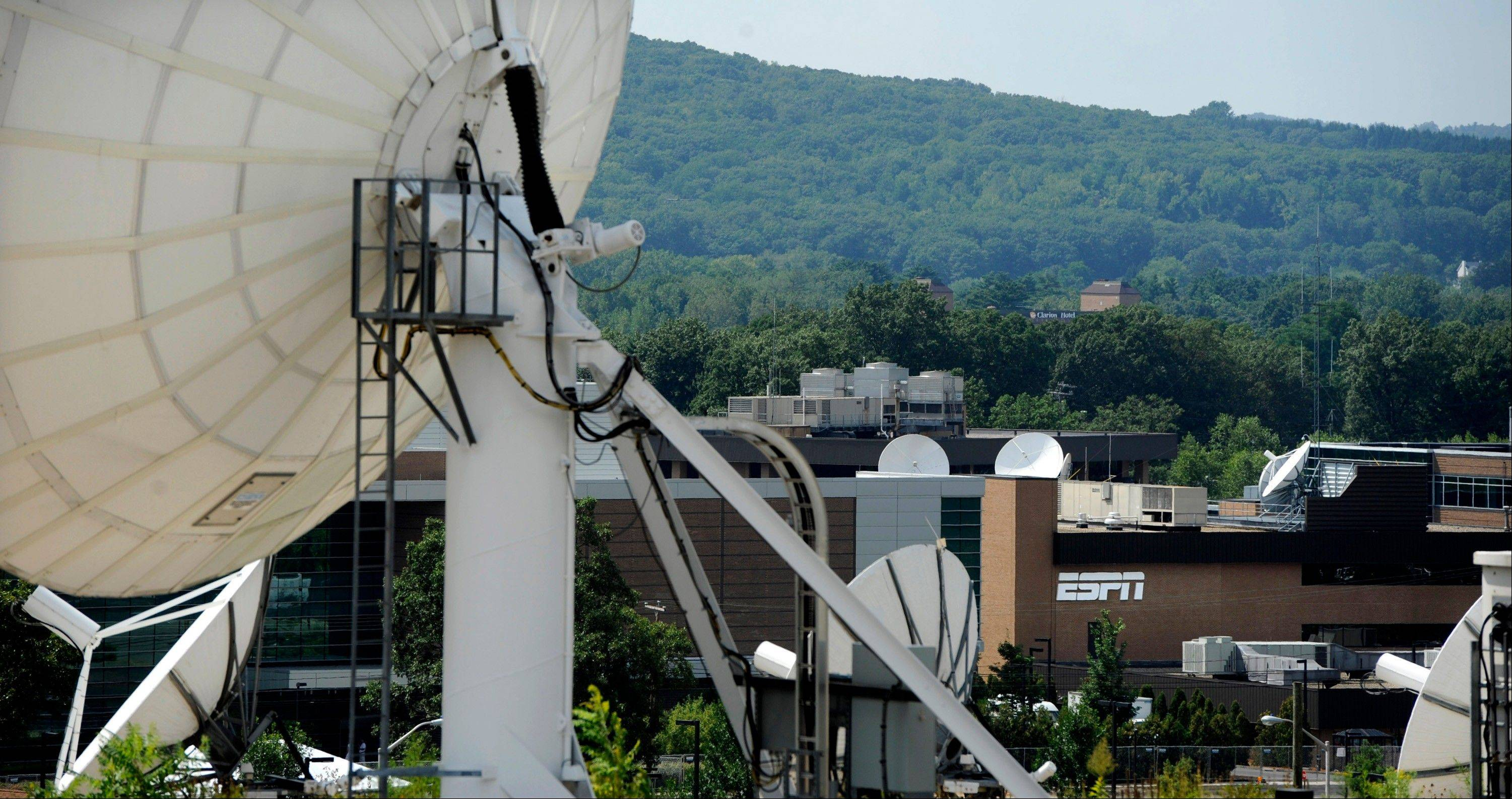 Associated Press/Aug. 2, 2011Satellite dishes dot the campus of ESPN in Bristol, Conn.
