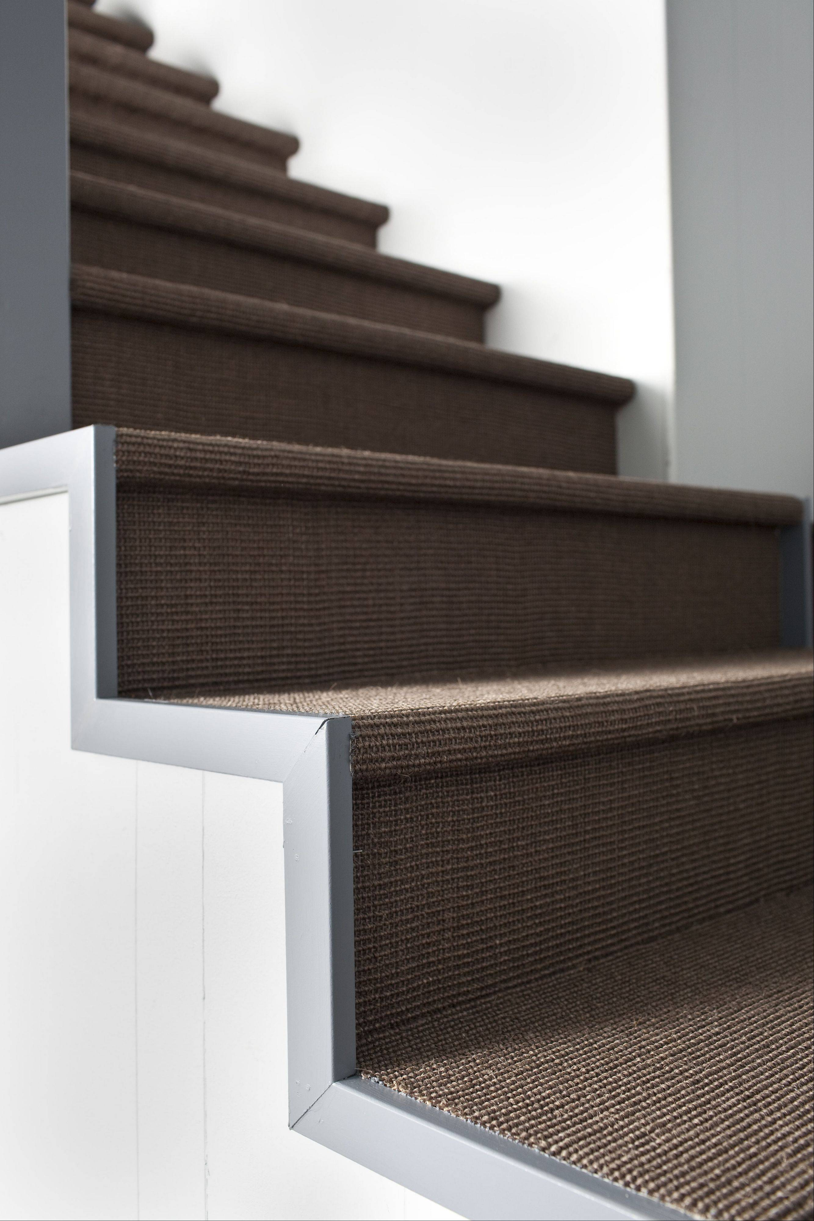 Brian Patrick Flynn used an organic fiber -- sisal -- to cover this basement staircase.