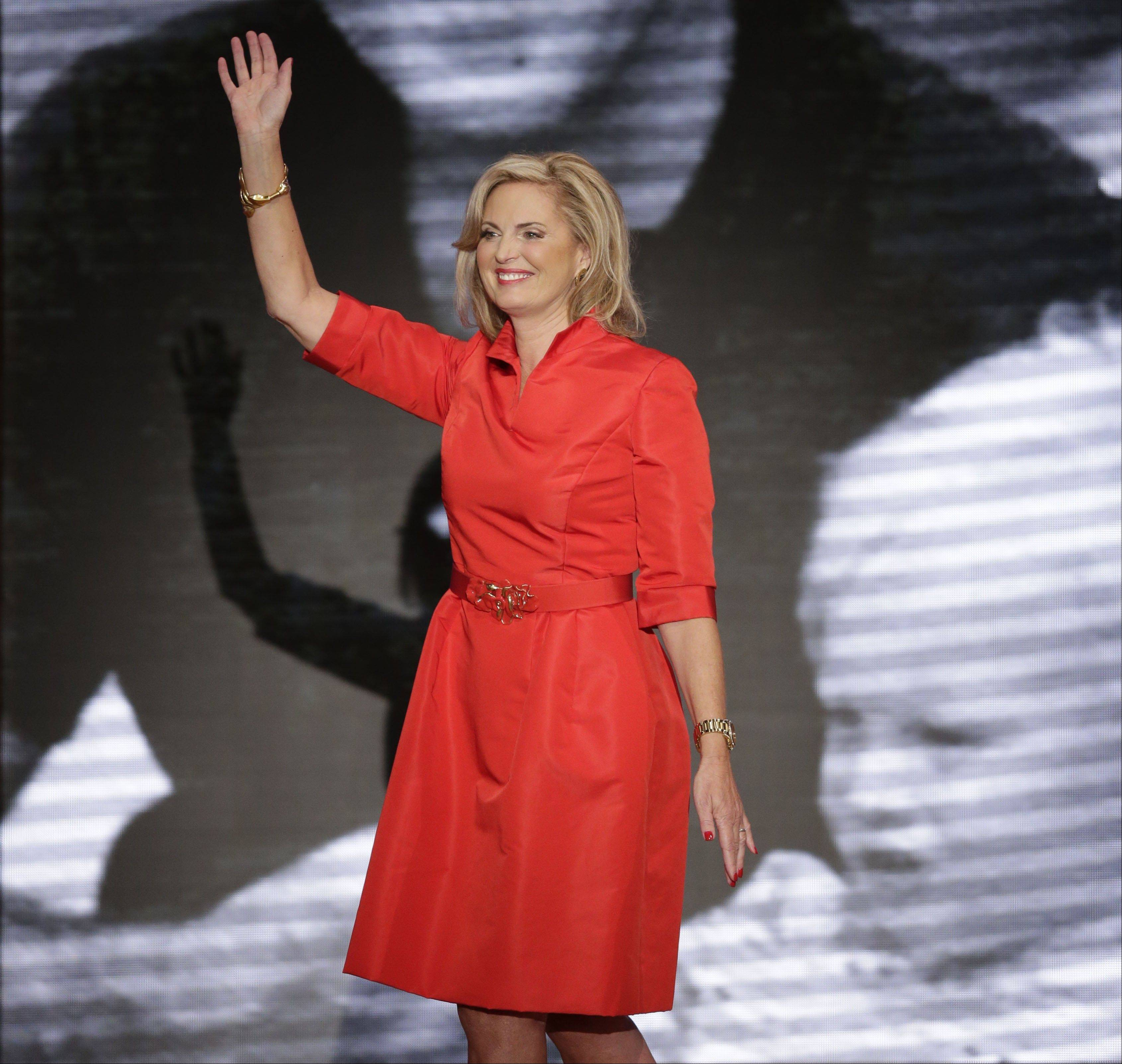 Ann Romney, wife of U.S. Republican presidential candidate Mitt Romney, wore a knee-length bright red belted dress designed by Oscar de la Renta during the Republican convention.