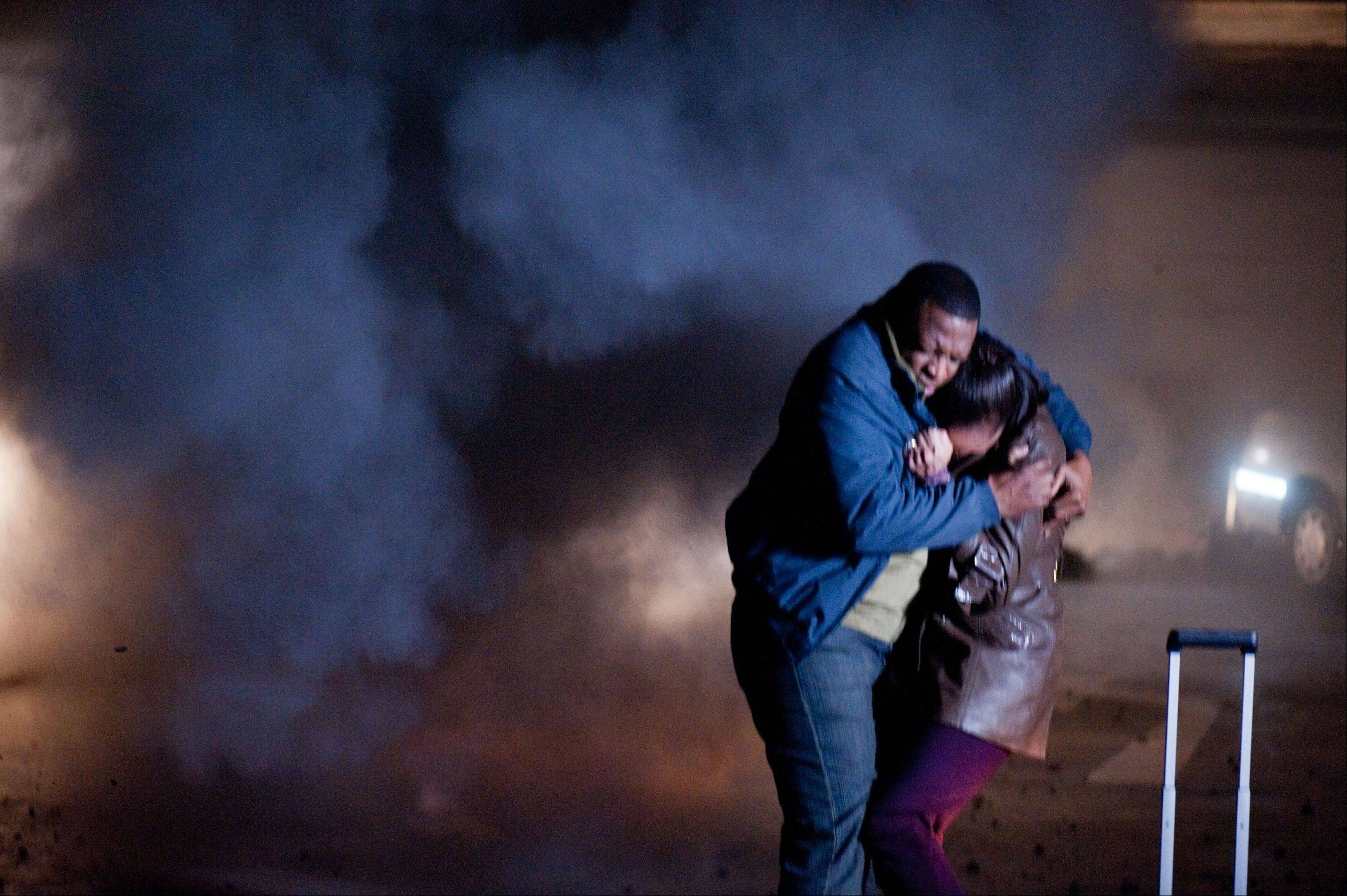 "This image released by Warner Premiere shows Melvin Abston as Lee Martin, left, and Nikki Crawford as Julie Martin in a scene from the new sci-fi series called ""H+ The Digital Series."" Made with a budget of just under $2 million, the 48-part series by filmmaker Bryan Singer has some of the best production value the Web has yet seen."