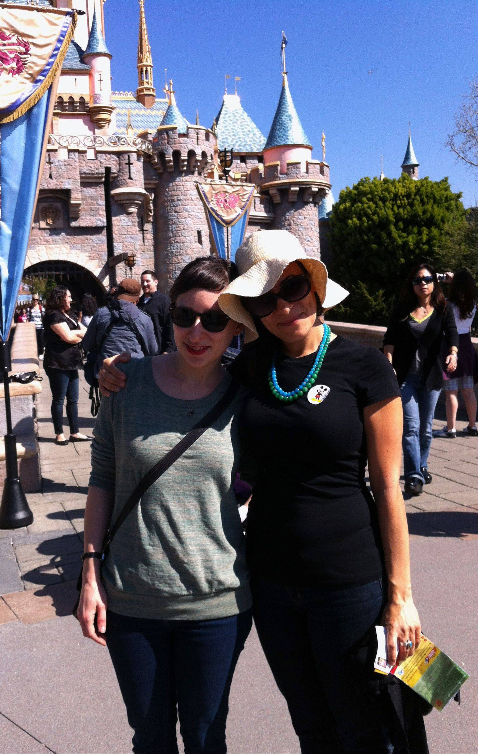 Solvej Schou, right, and her childhood friend, Joanna Sondheim, stand in front of Sleeping Beauty's Castle at Disneyland in Anaheim, Calif., and rekindle memories after a day at the amusement park.