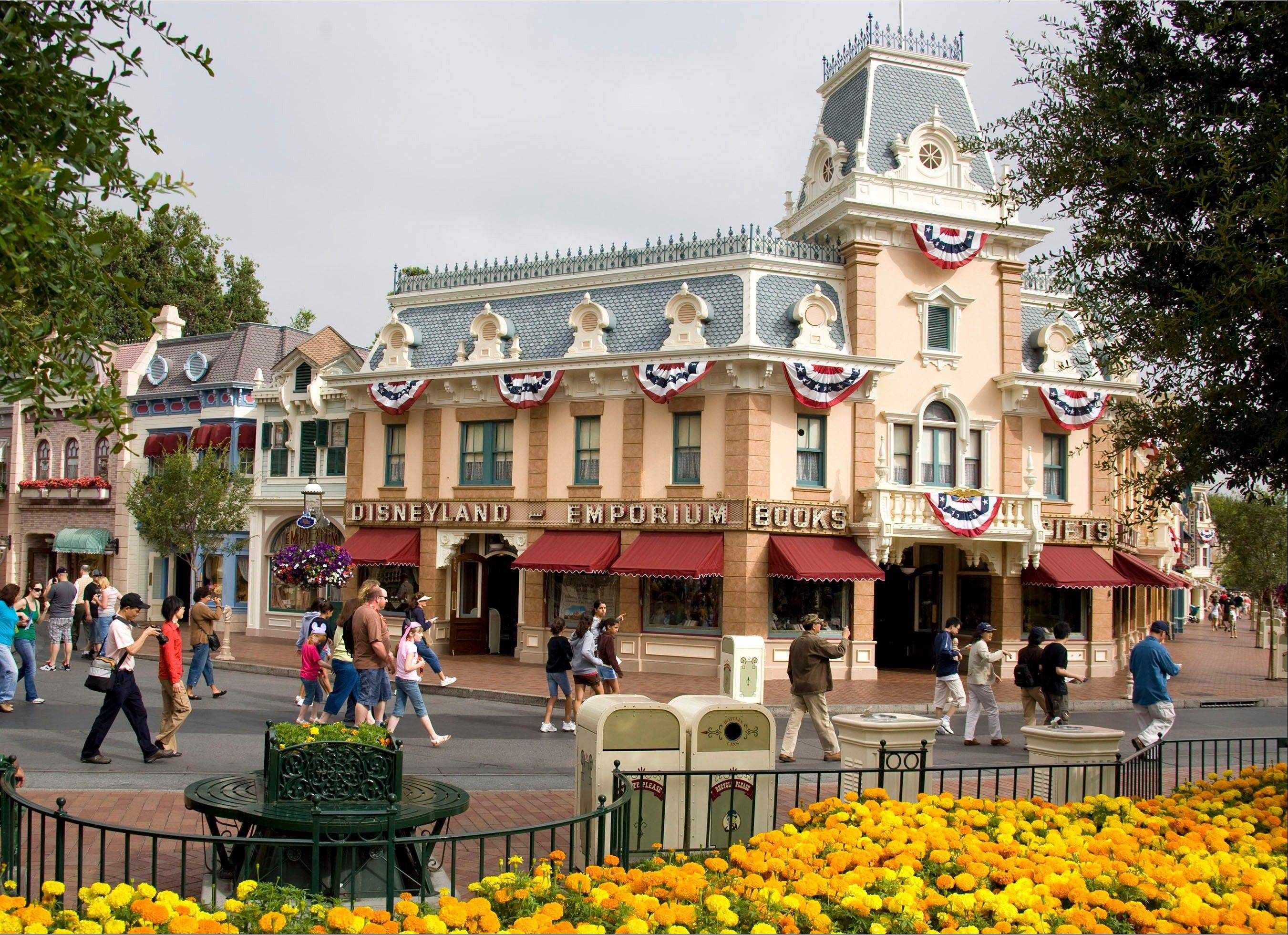 Guests walk along Main Street U.S.A. at the Disneyland theme park.
