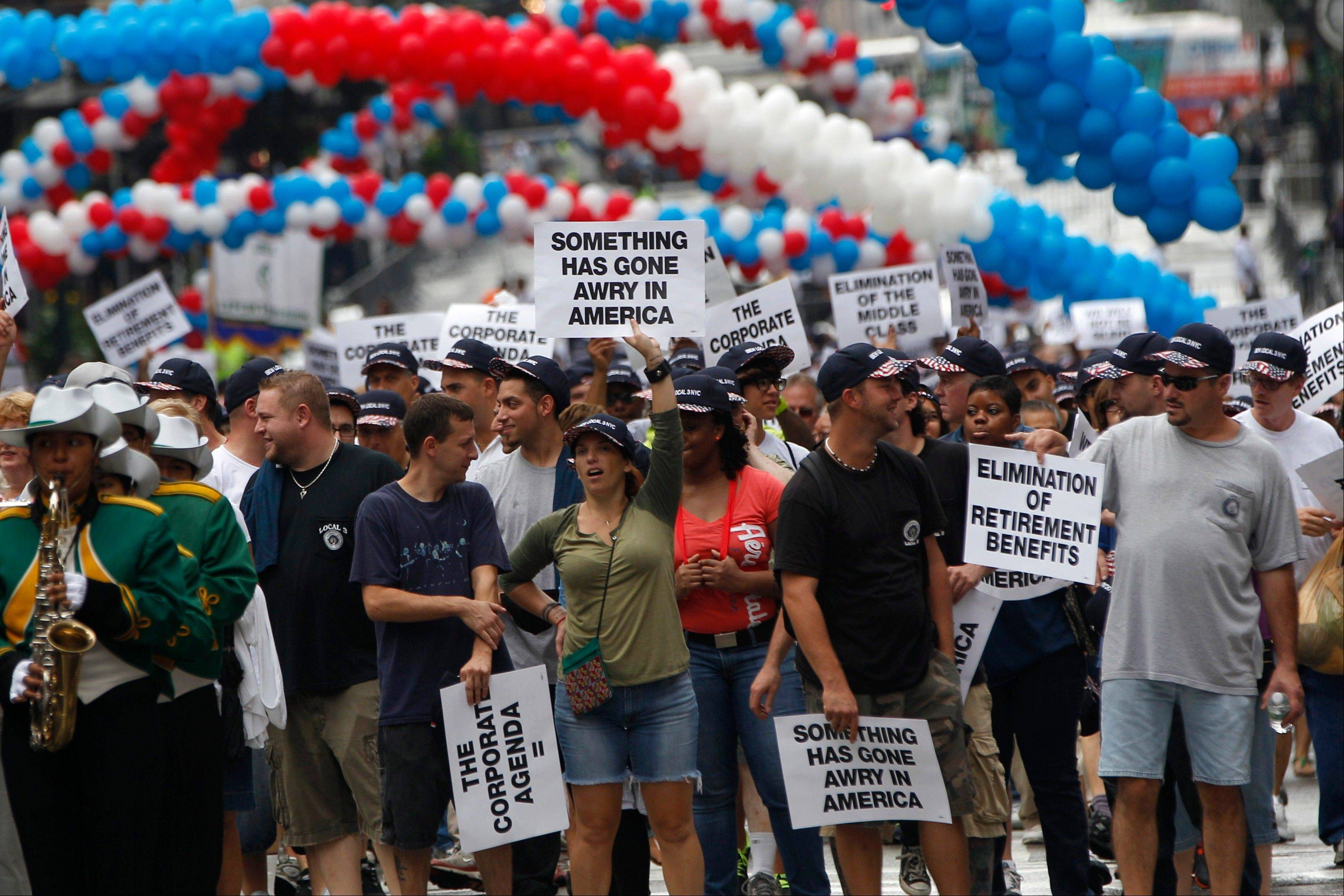 Union members march up Fifth Ave Saturday during the Labor Day parade.
