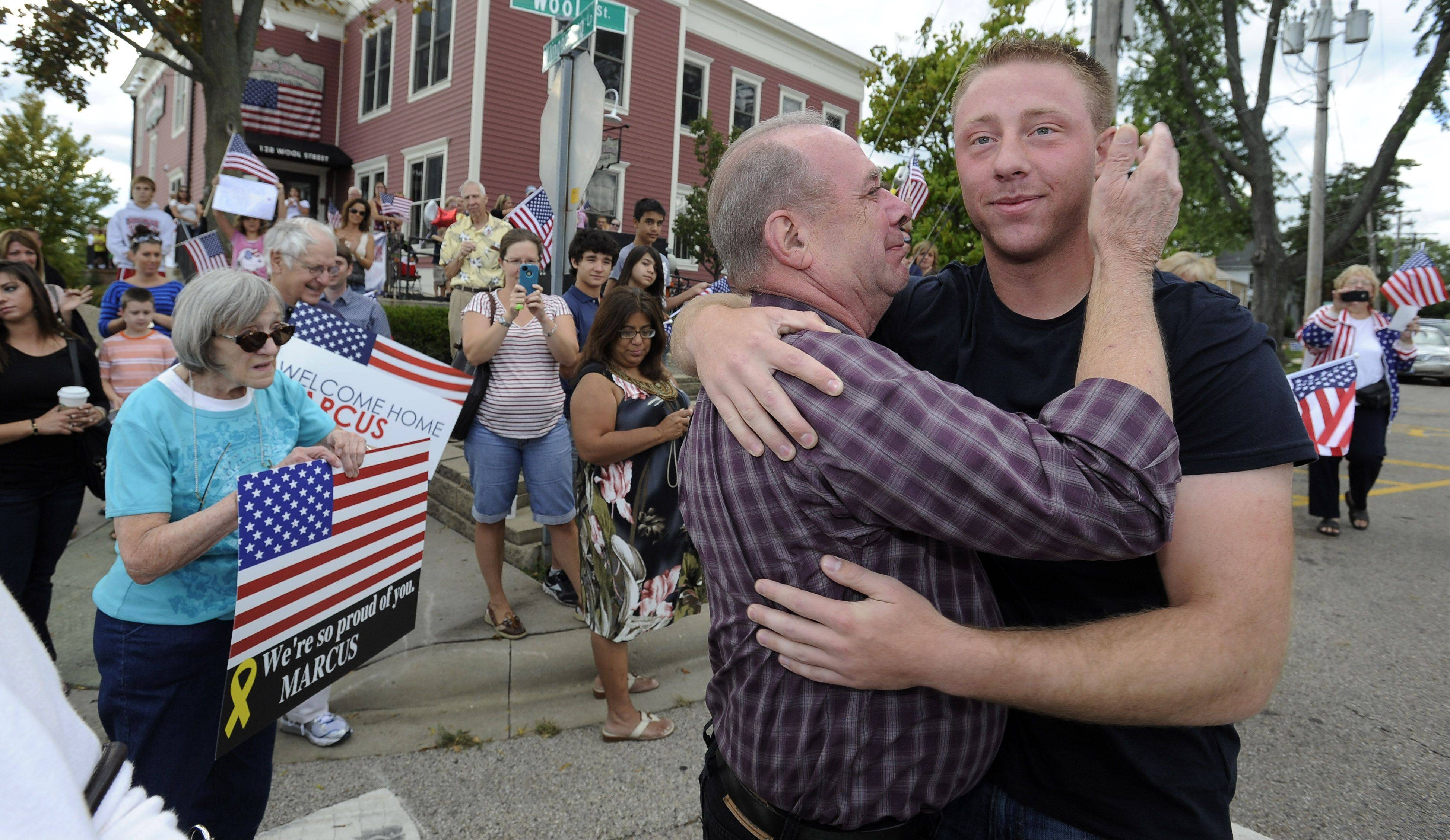 A overwhelmed Jerry Kuiper, grandfather to Cpl. Marcus Kuiper, 22, of Barrington welcomes him home Saturday after his second tour in Afghanistan.