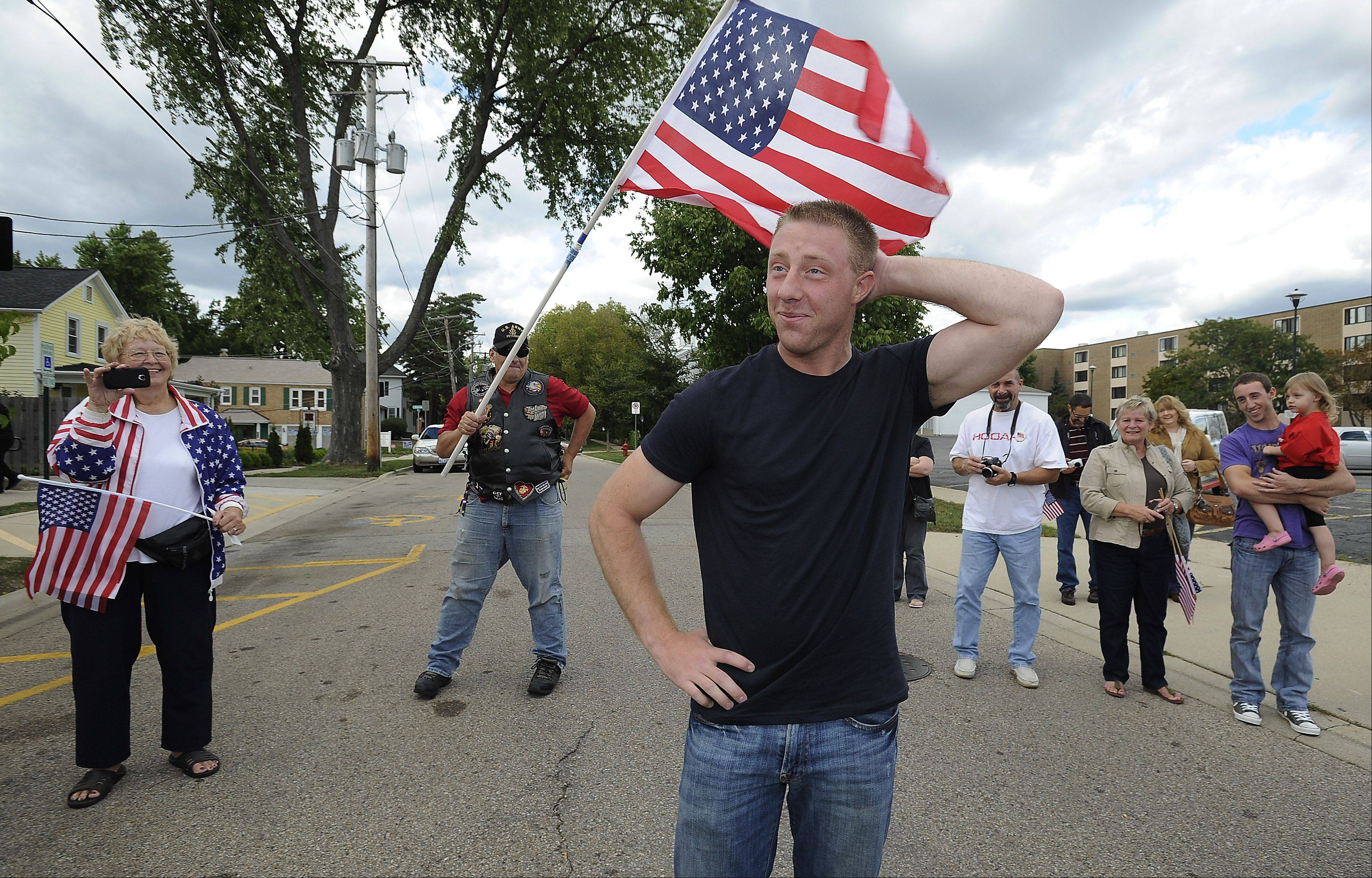 Feeling a bit overwhelmed, Cpl. Marcus Kuiper, 22, of Barrington is welcomed home Saturday after his second tour in Afghanistan by his friends and family members.