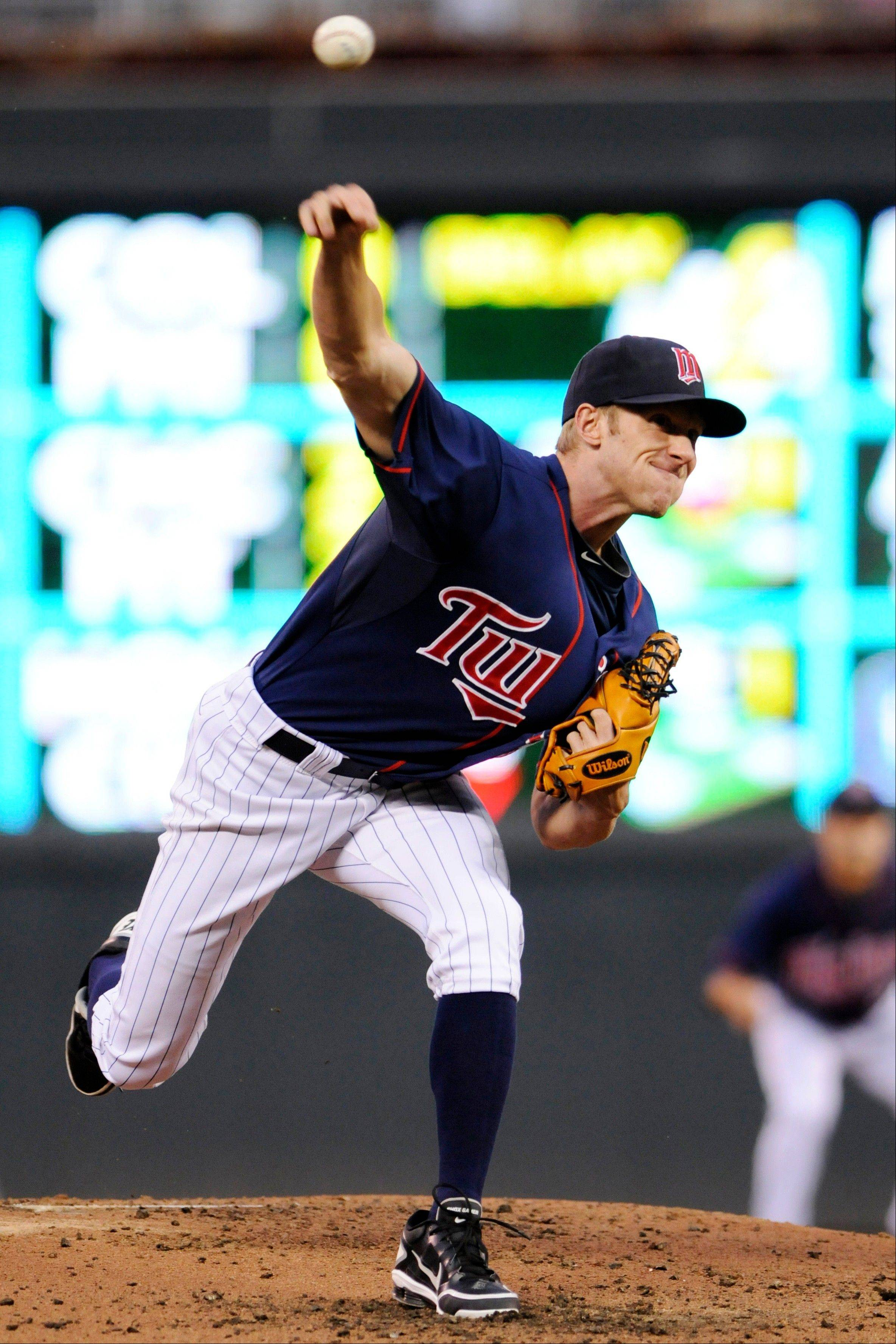 Twins pitcher Cole DeVries throws against the Cleveland Indians in the second inning Saturday in Minneapolis.