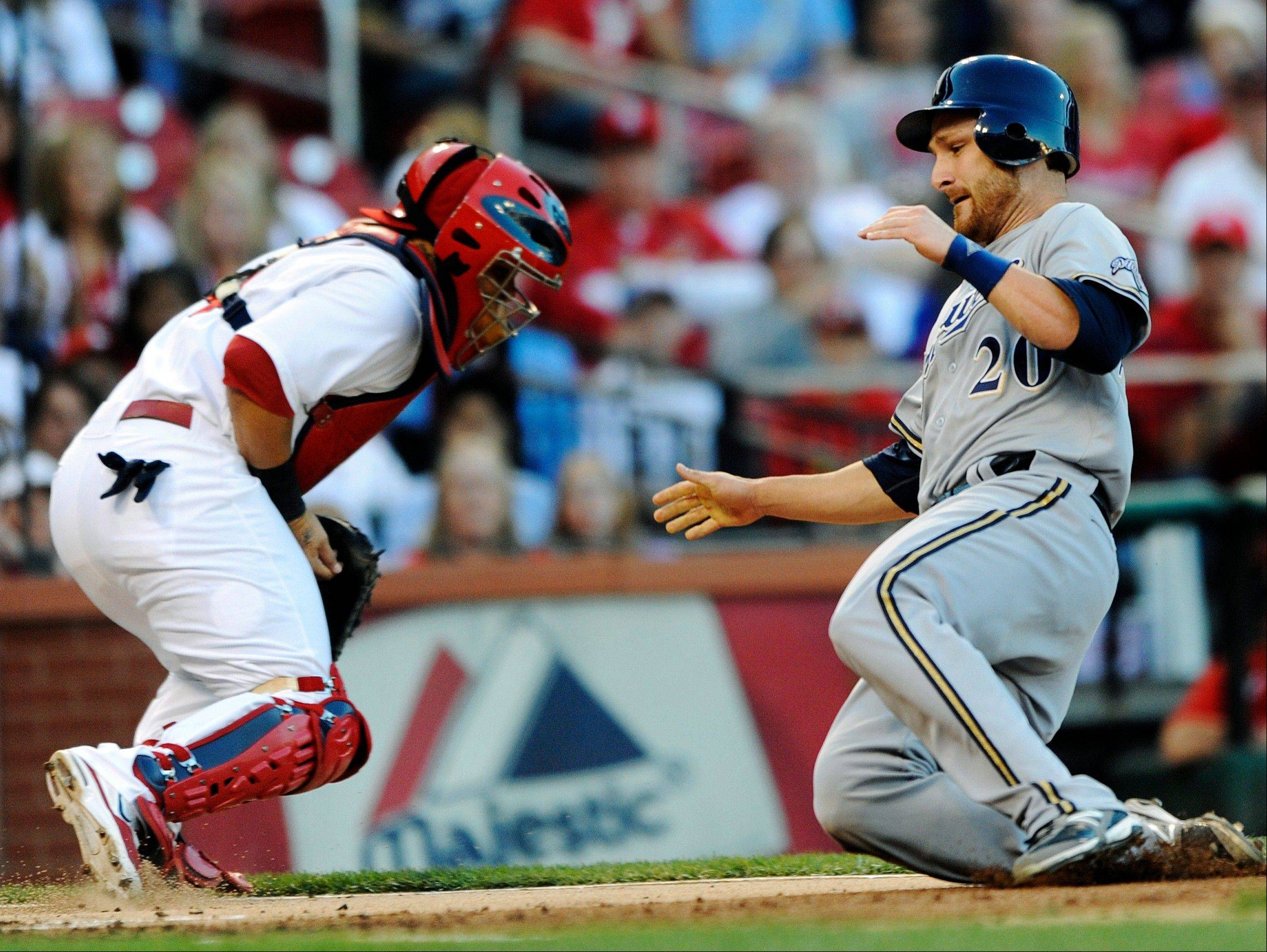 Milwaukee's Jonathan Lucroy scores on a hit by Mike Fiers in the second inning Saturday at Busch Stadium in St. Louis.