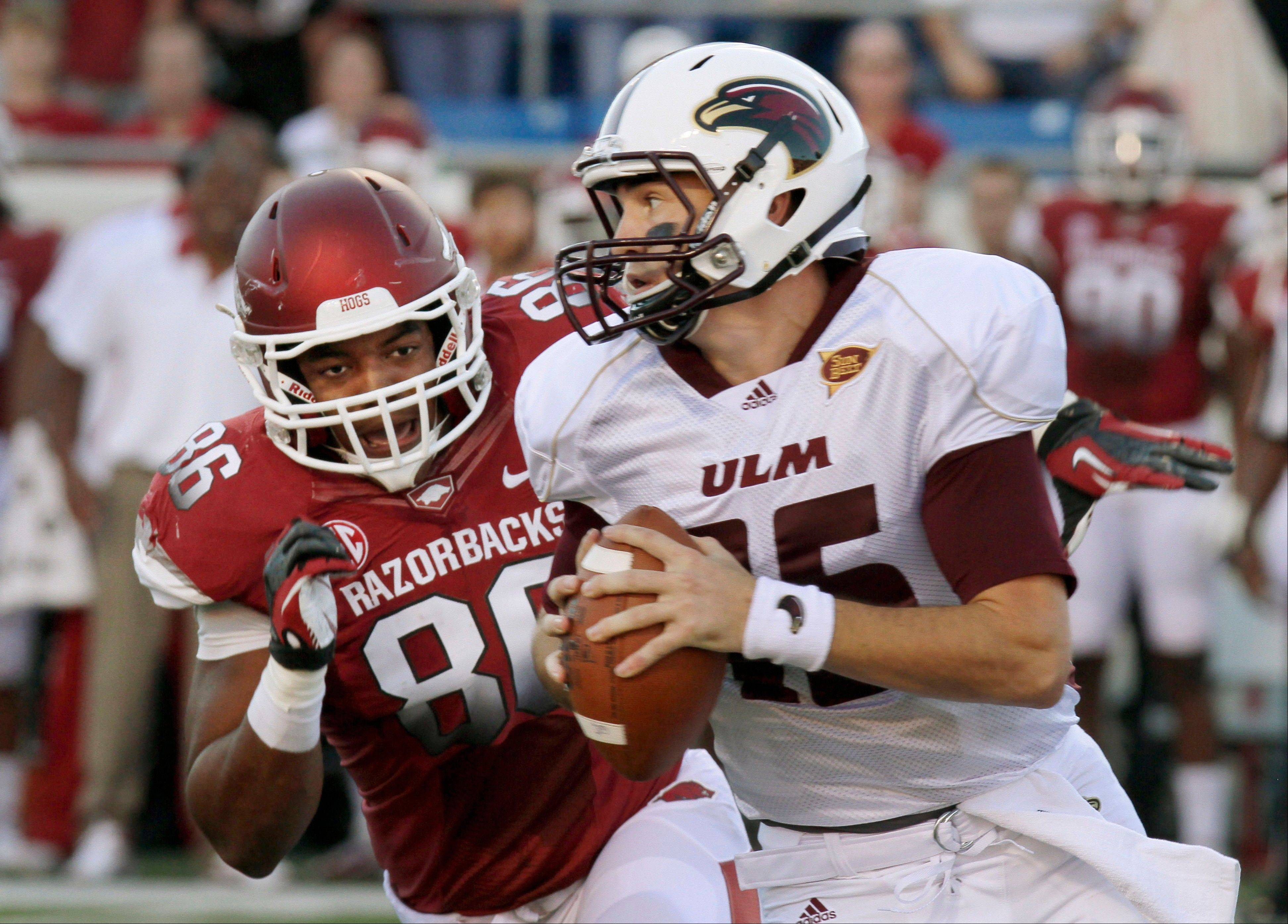Arkansas defensive end Trey Flowers (86) pressures Louisiana Monroe quarterback Kolton Browning (15) during the first quarter Saturday in Little Rock, Ark.