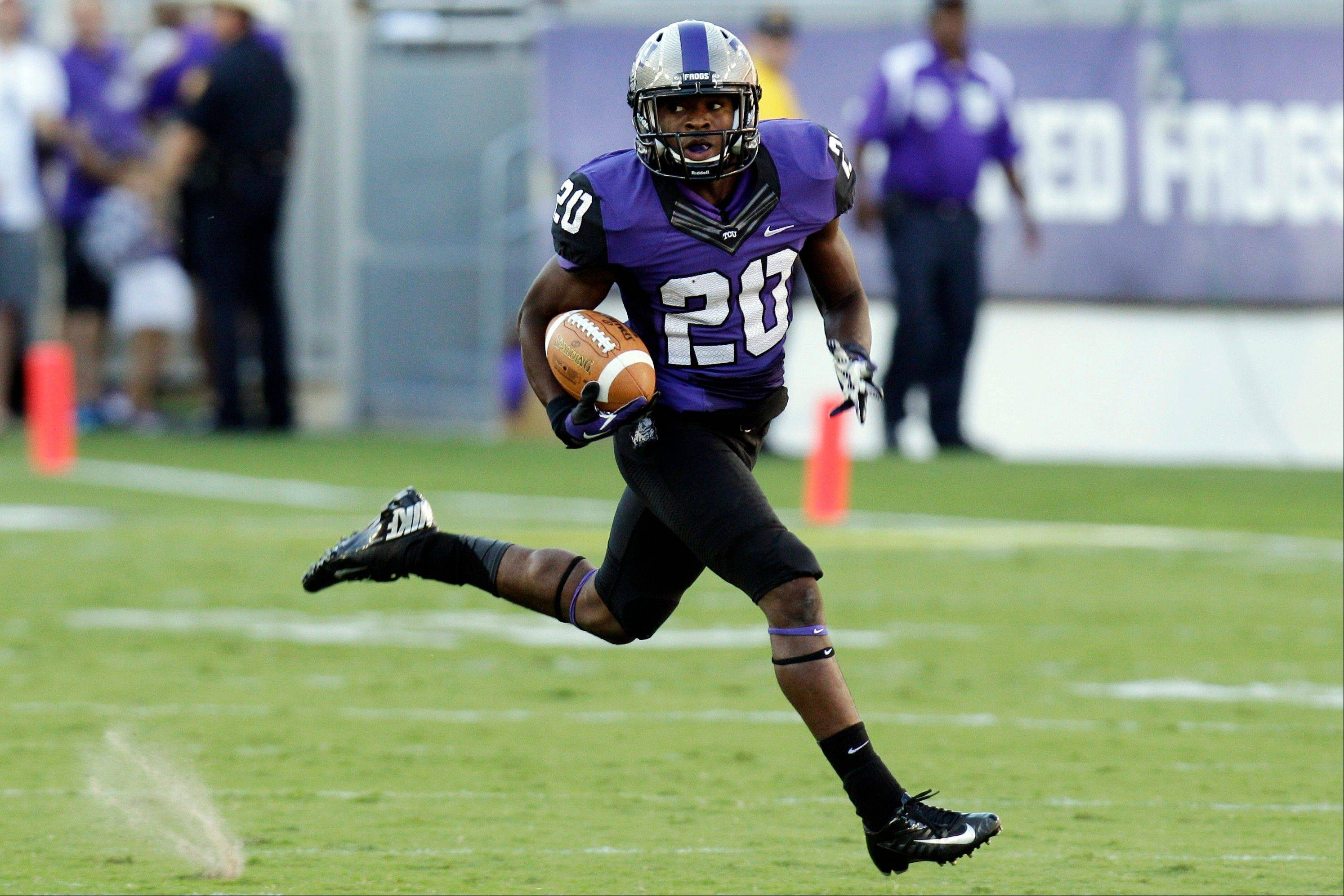 TCU running back Aaron Green runs back a punt return for a touchdown during the first half Saturday against Grambling State in Fort Worth, Texas.