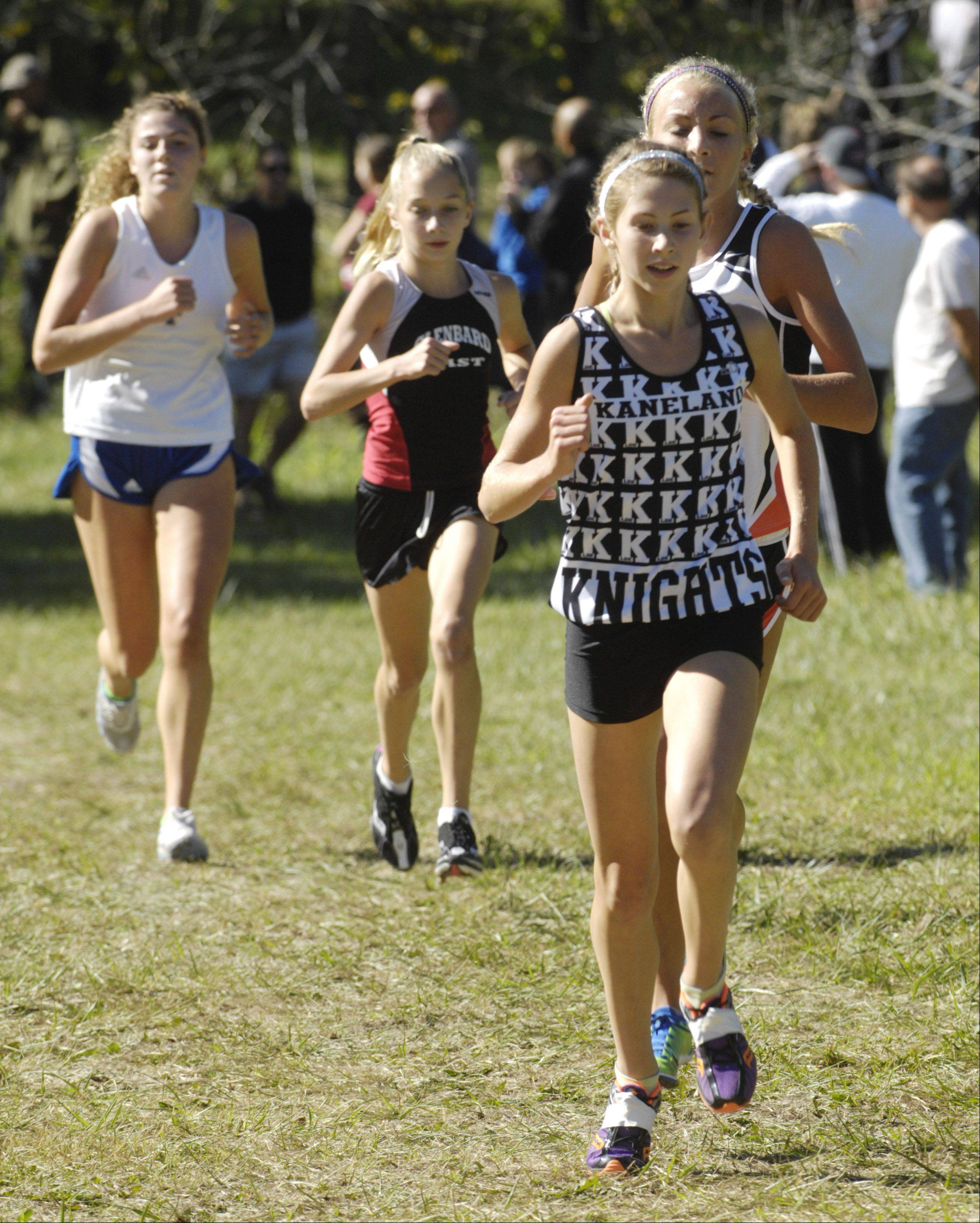 Kaneland's Victoria Clinton, who finished second, has a slight lead on Crystal Lake Central's Sami Staples, who finished first, during the Wauconda cross country invitational at Lakewood Forest Preserve Saturday.