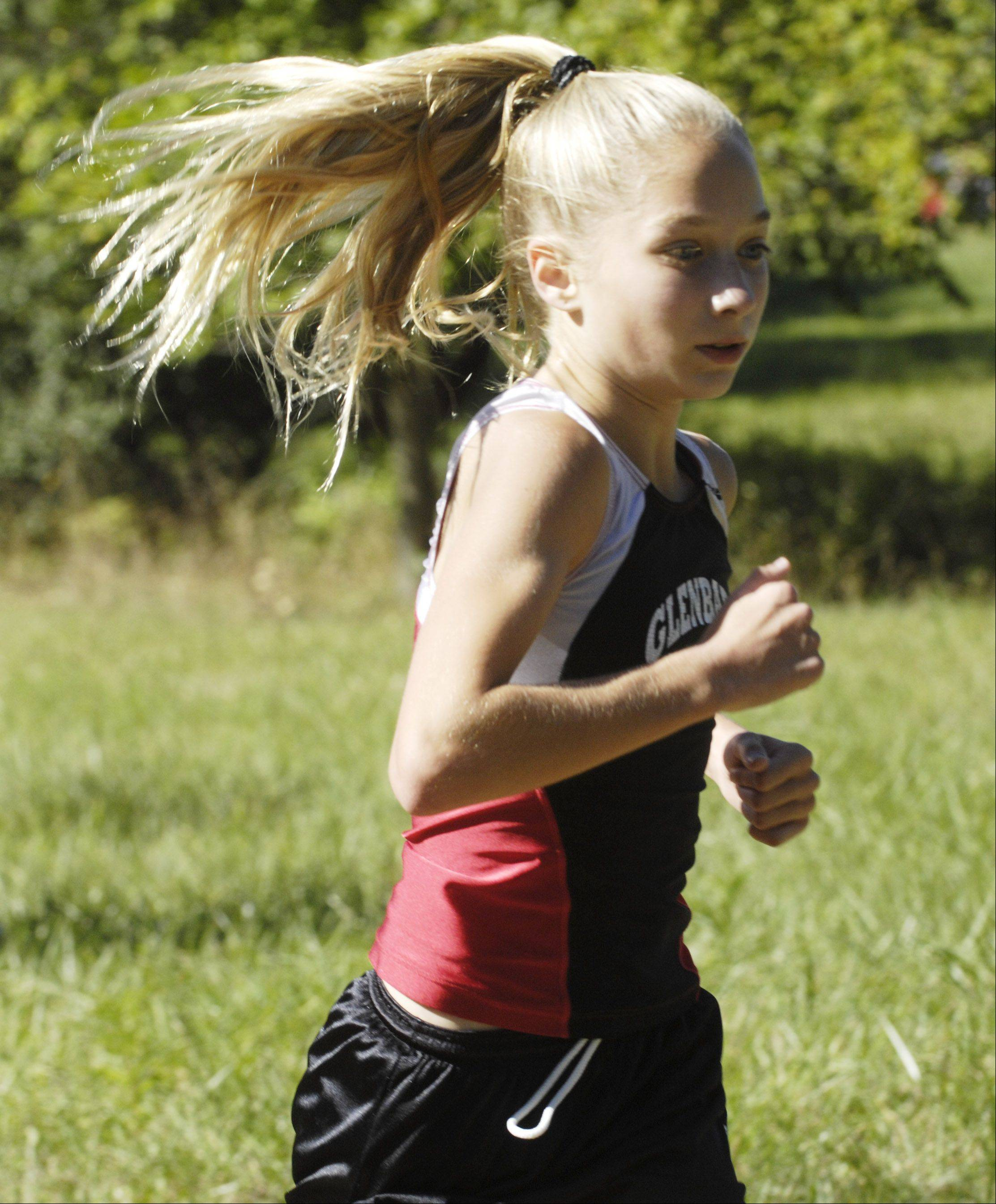 Glenbard East's Lindsay Graham runs toward a third-place finish during the Wauconda cross country invitational at Lakewood Forest Preserve Saturday.
