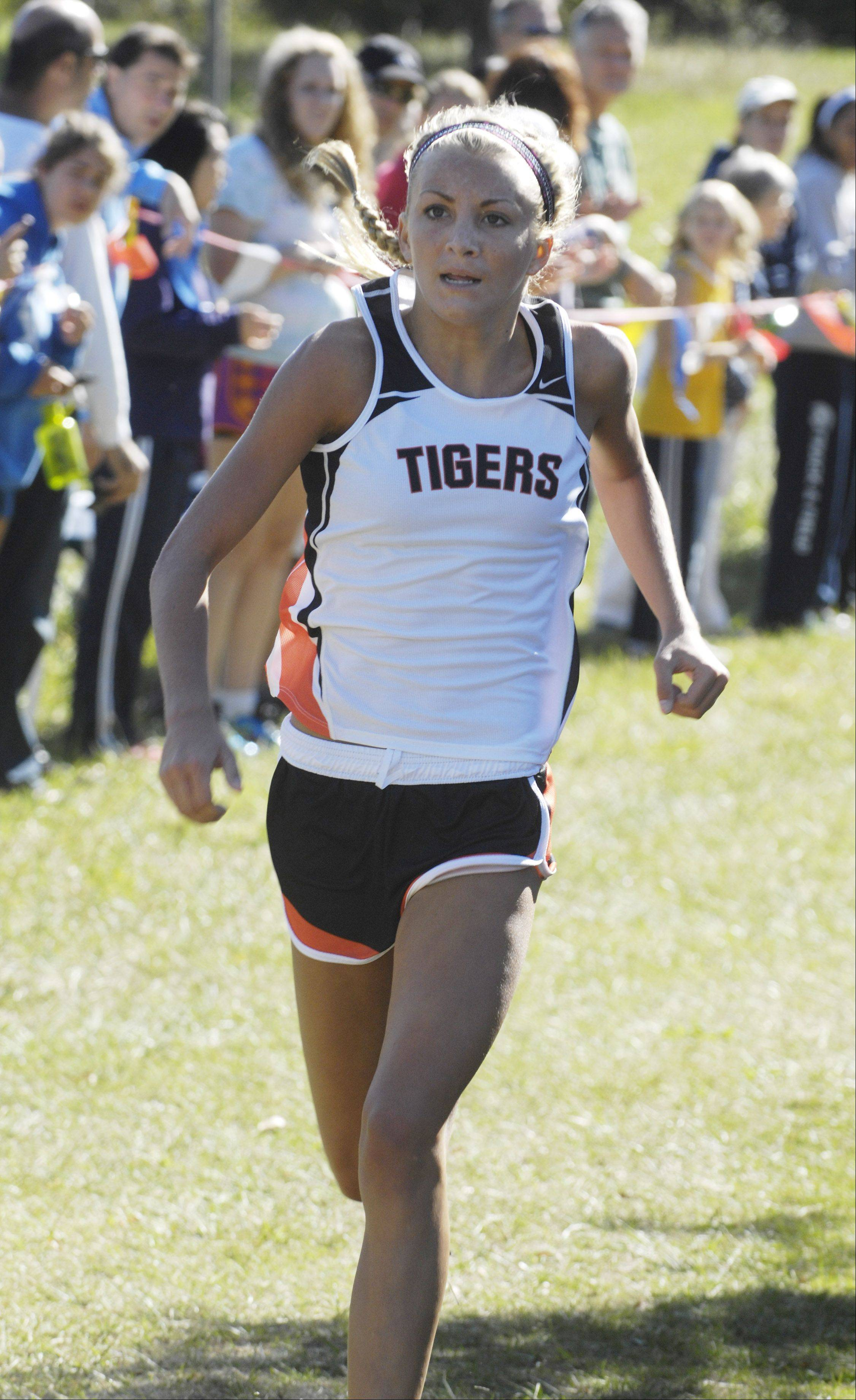 Crystal Lake Central's Sami Staples wins the Wauconda cross country invitational at Lakewood Forest Preserve Saturday.