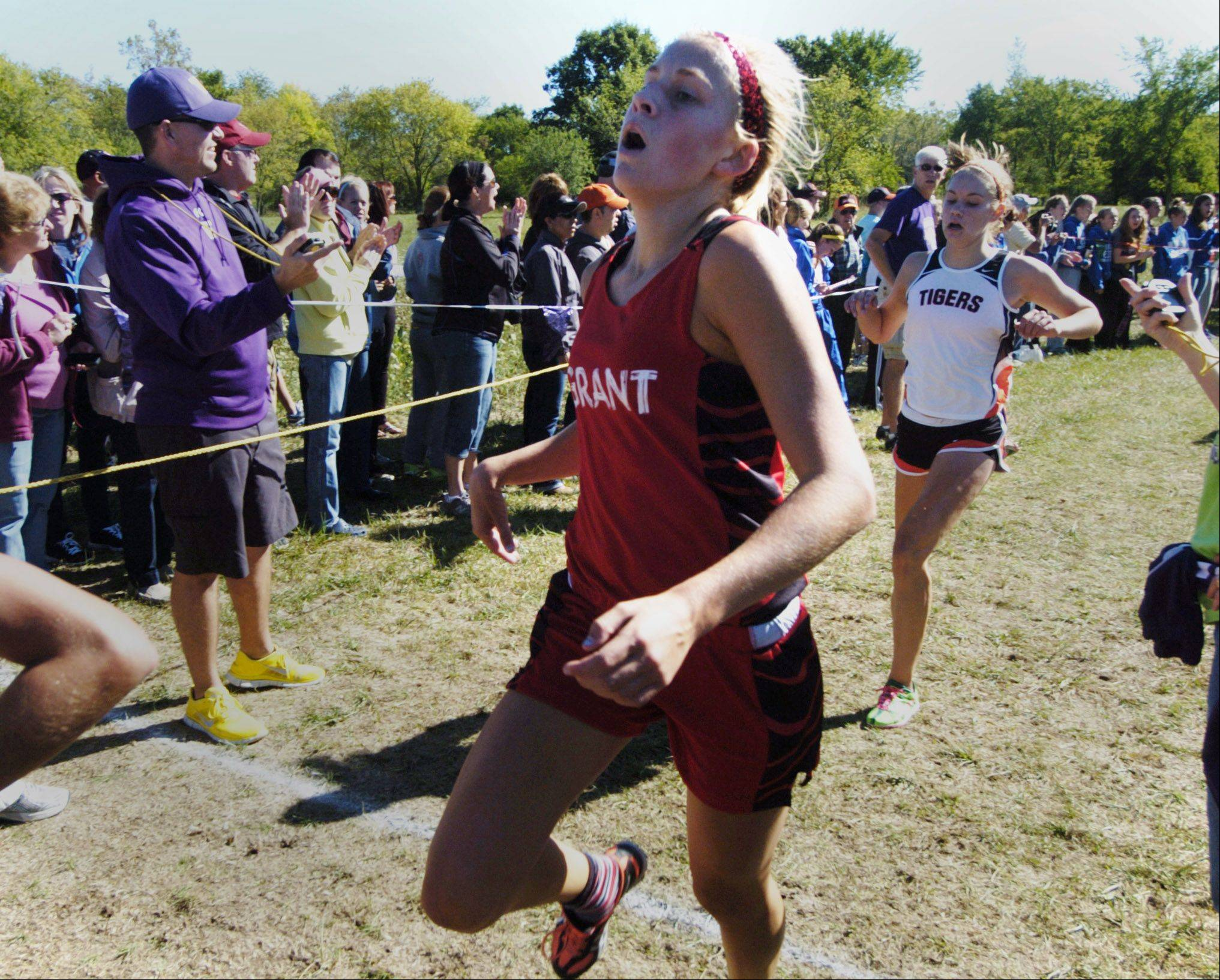 Grant's Lindsey Lewis finishes seventh during the Wauconda cross country invitational at Lakewood Forest Preserve Saturday.