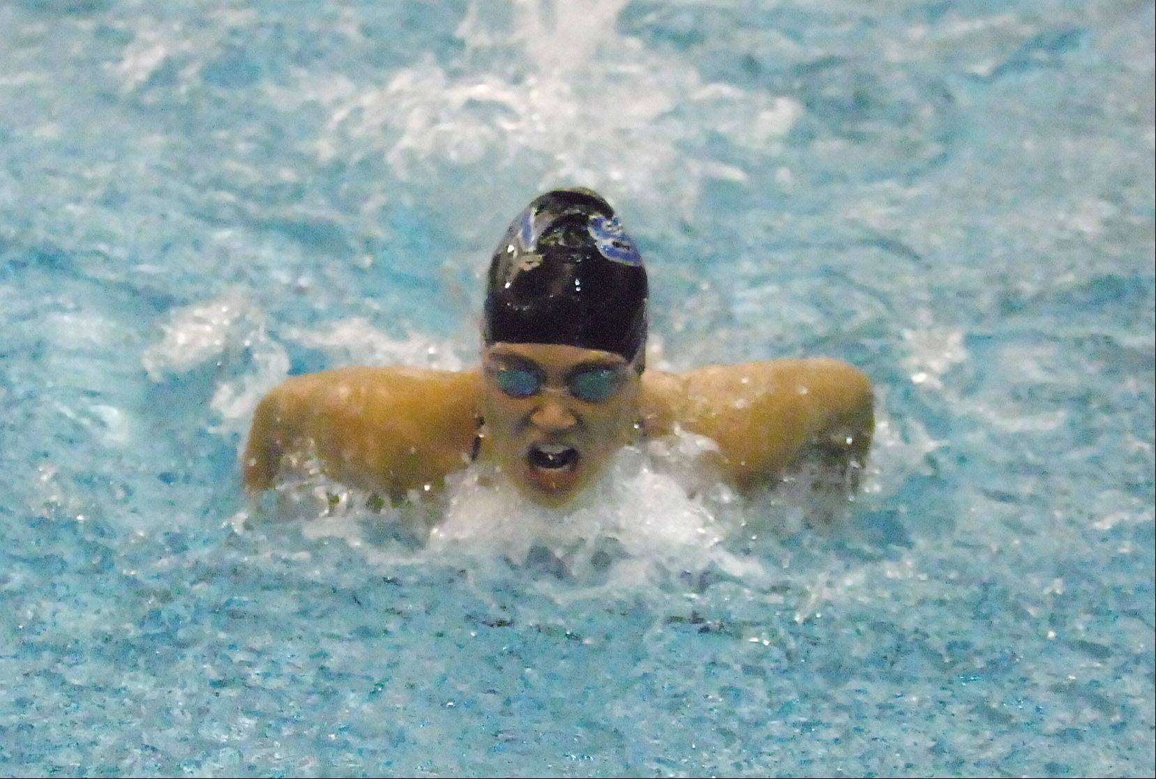 Chloe Tykal of Saint Charles North swims the 200 IM during the Neuqua Valley girls swimming invitational Saturday.