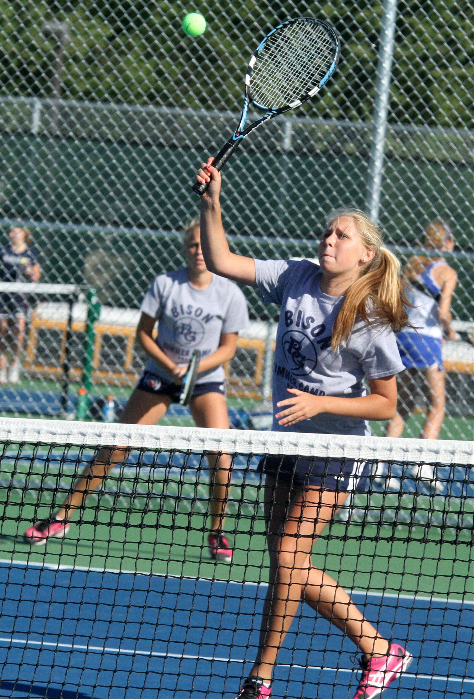 Buffalo Grove High School twins Lauren Goggin, foreground, and Dana play doubles against Lake Zurich's Melanie Spears and Sam Wilson at Buffalo Grove High School girls tennis invitational on Saturday, September 8.