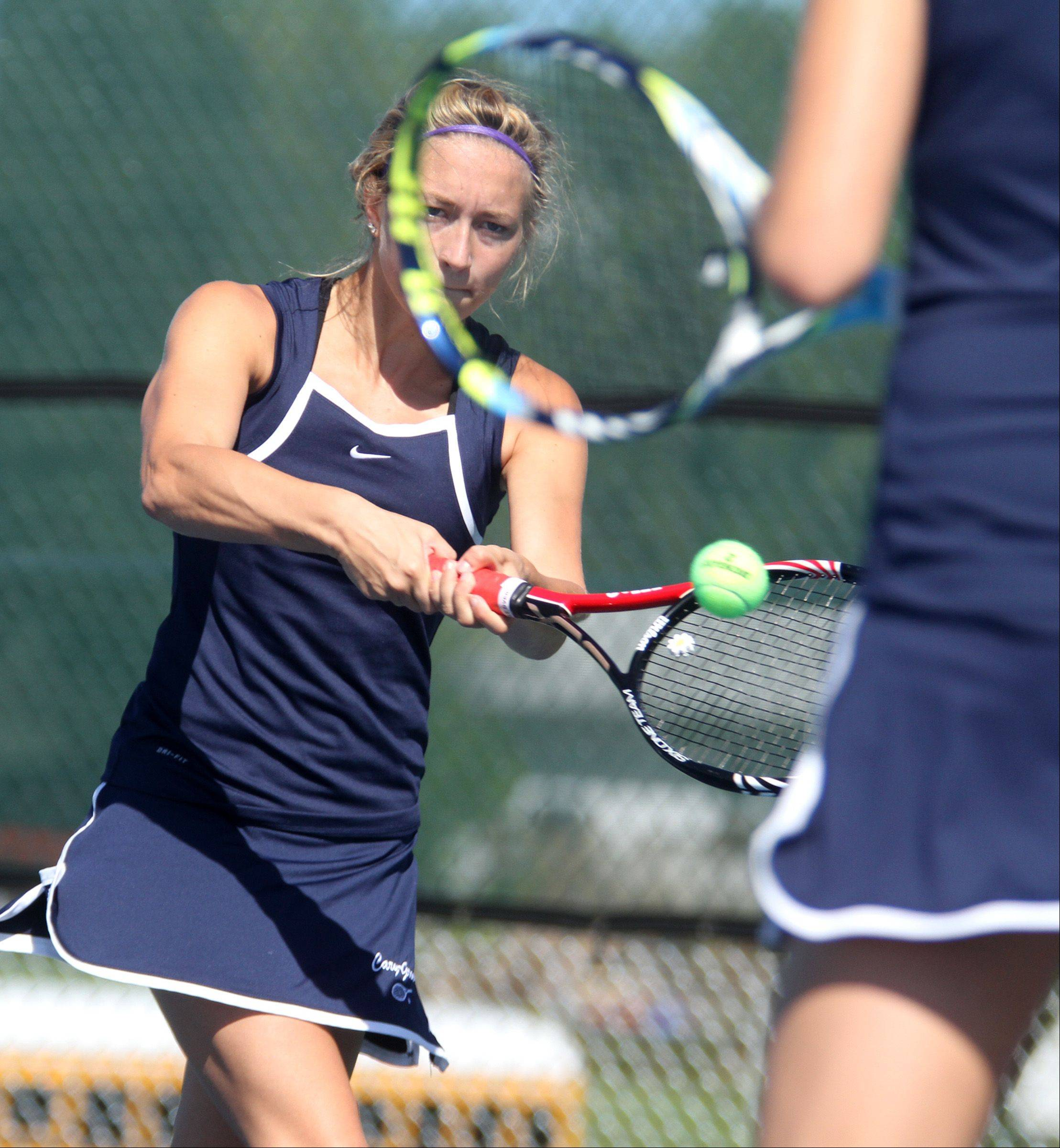 Cary-Grove High School's Alyssa Derer charges the ball framed by teammate Macy Koepke's racket in doubles against Hersey's Meredith Ward and Megan Salt at Buffalo Grove High School girls tennis invitational on Saturday, September 8.