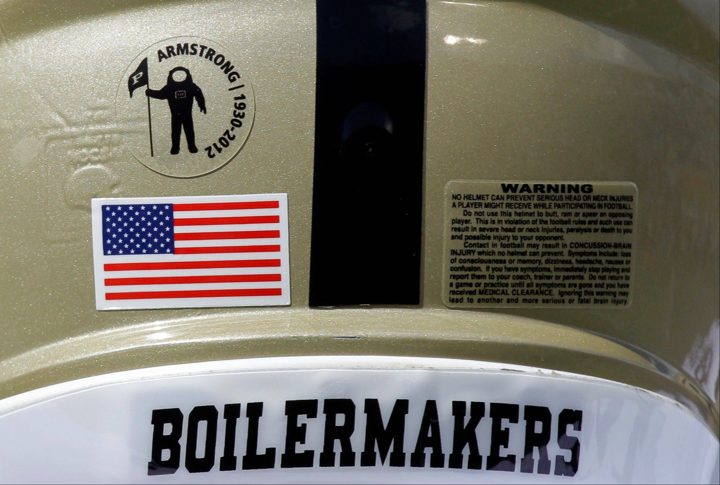 A tribute to astronaut Neil Armstrong, the first man to walk on the moon, appears on the back of the helmet of Purdue quarterback Caleb TerBush before Purdue's NCAA college football game against Notre Dame in South Bend, Ind., Saturday. Armstrong, who died last month, was a graduate of Purdue.
