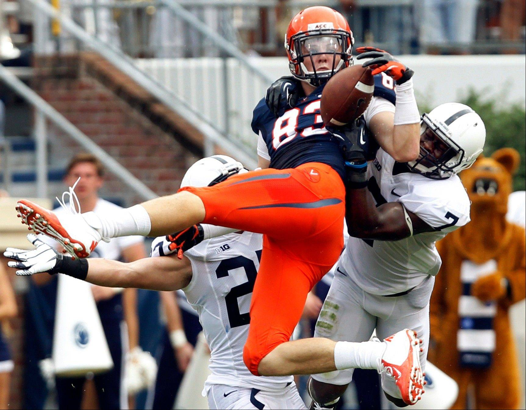Virginia tight end Jake McGee makes a reception in front of Penn State linebacker T.J. Rhattigan (22) and safety Stephen Obeng-Agyapong (7) during the second half Saturday in Charlottesville, Va.