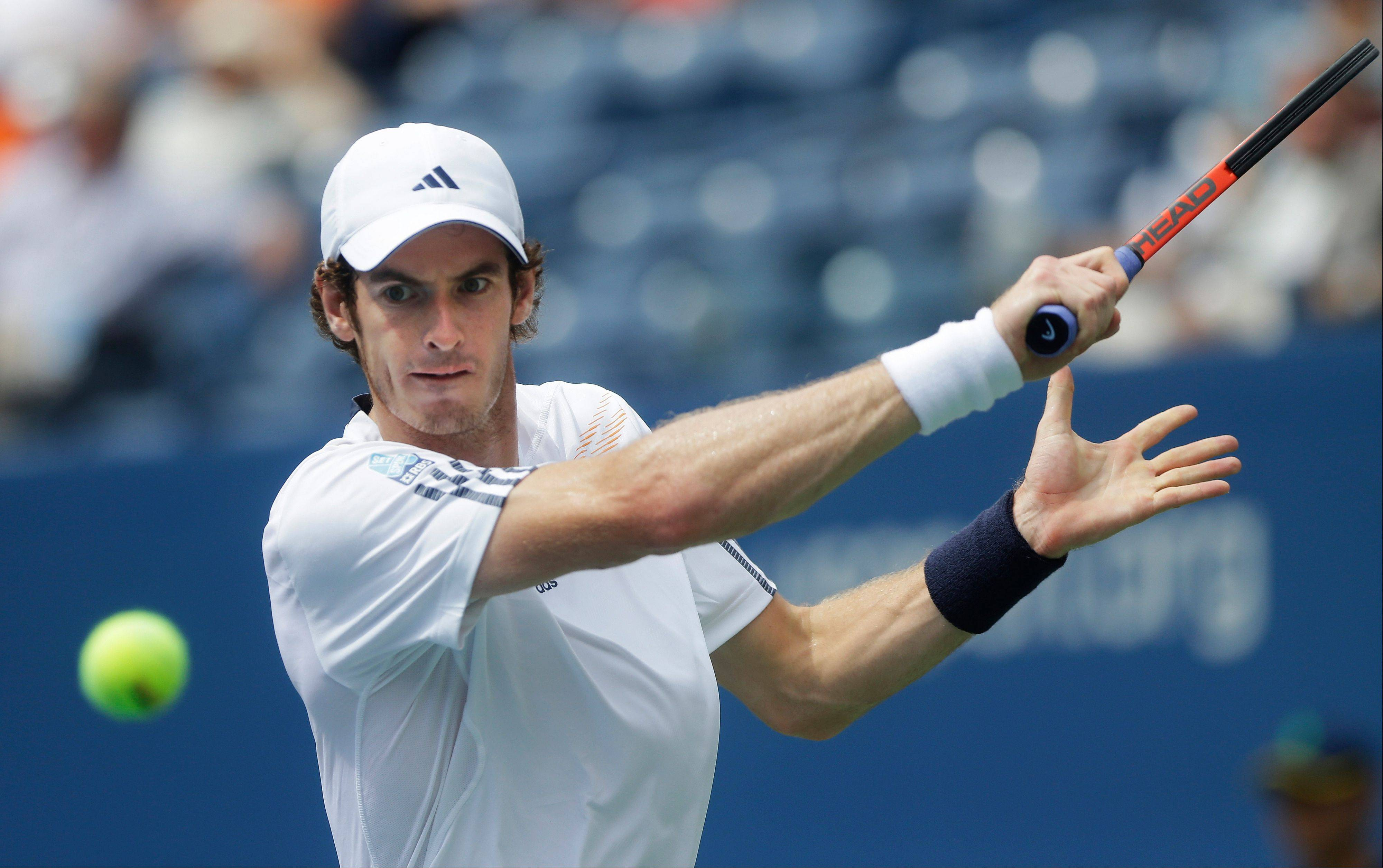 Britain's Andy Murray returns a shot to Czech Republic's Tomas Berdych during a semifinal match Saturday at the U.S. Open in New York.