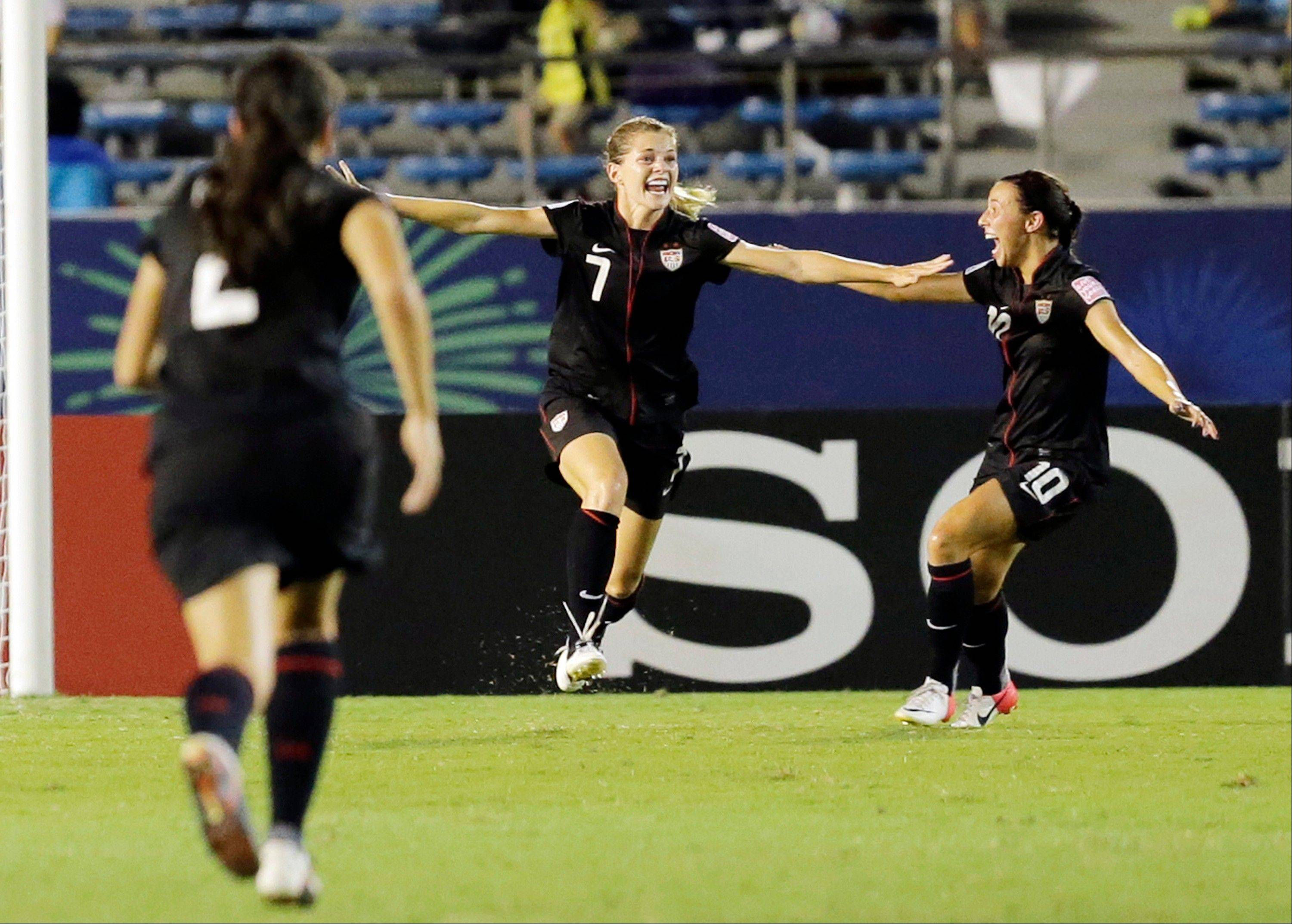Kealia Ohai of United States,center, celebrates with Vanessa Di Bernardo (10) of Naperville after Ohai scored a goal during final match of the U20 Women's World Cup against Germany in Tokyo on Saturday.
