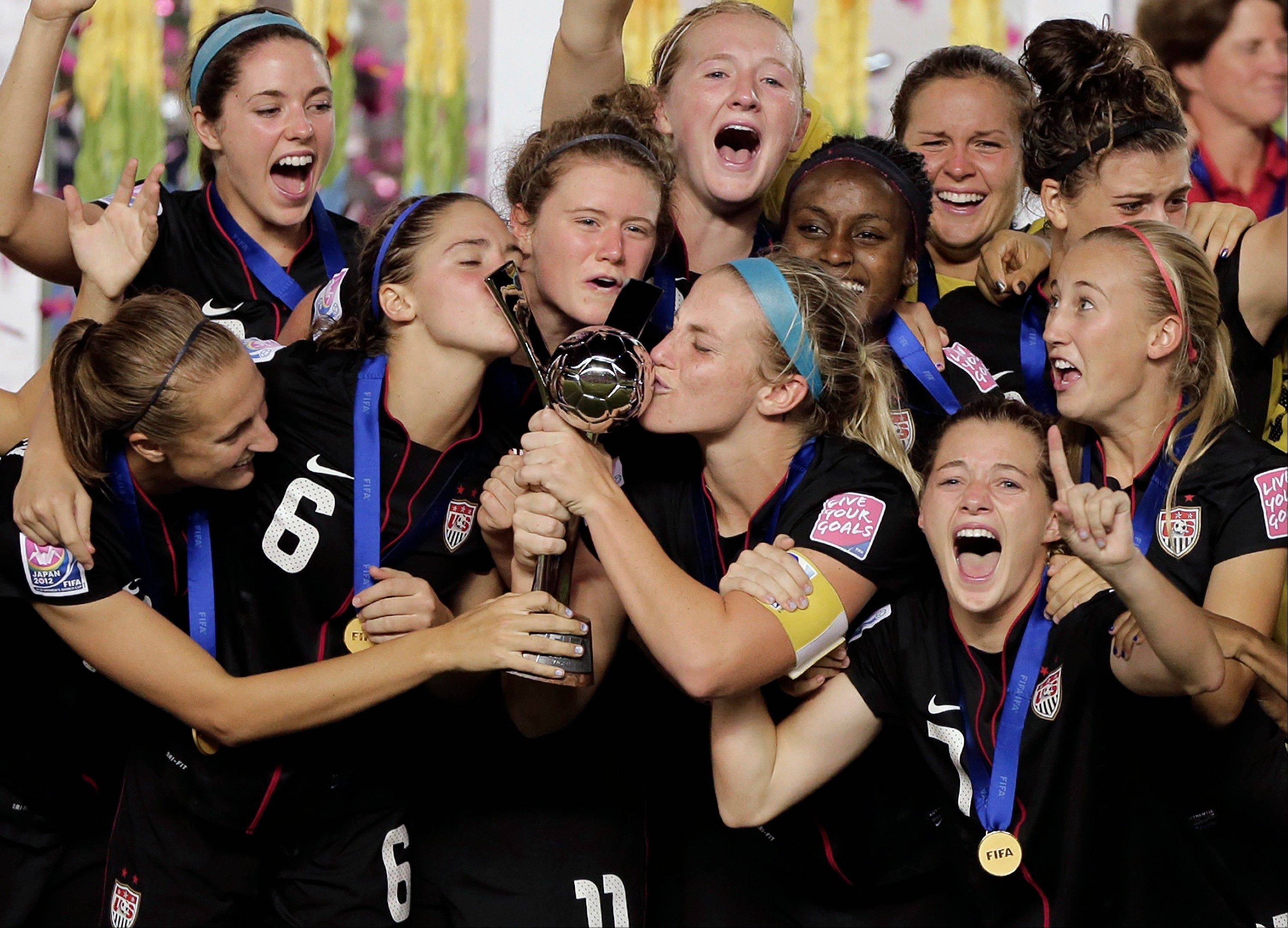 Associated Press The U.S. women's soccer Captain Julie Johnston, center, kisses the trophy as she celebrates with her teammates after defeating Germany 1-0 to win the U20 women's World Cup final in Tokyo on Saturday.