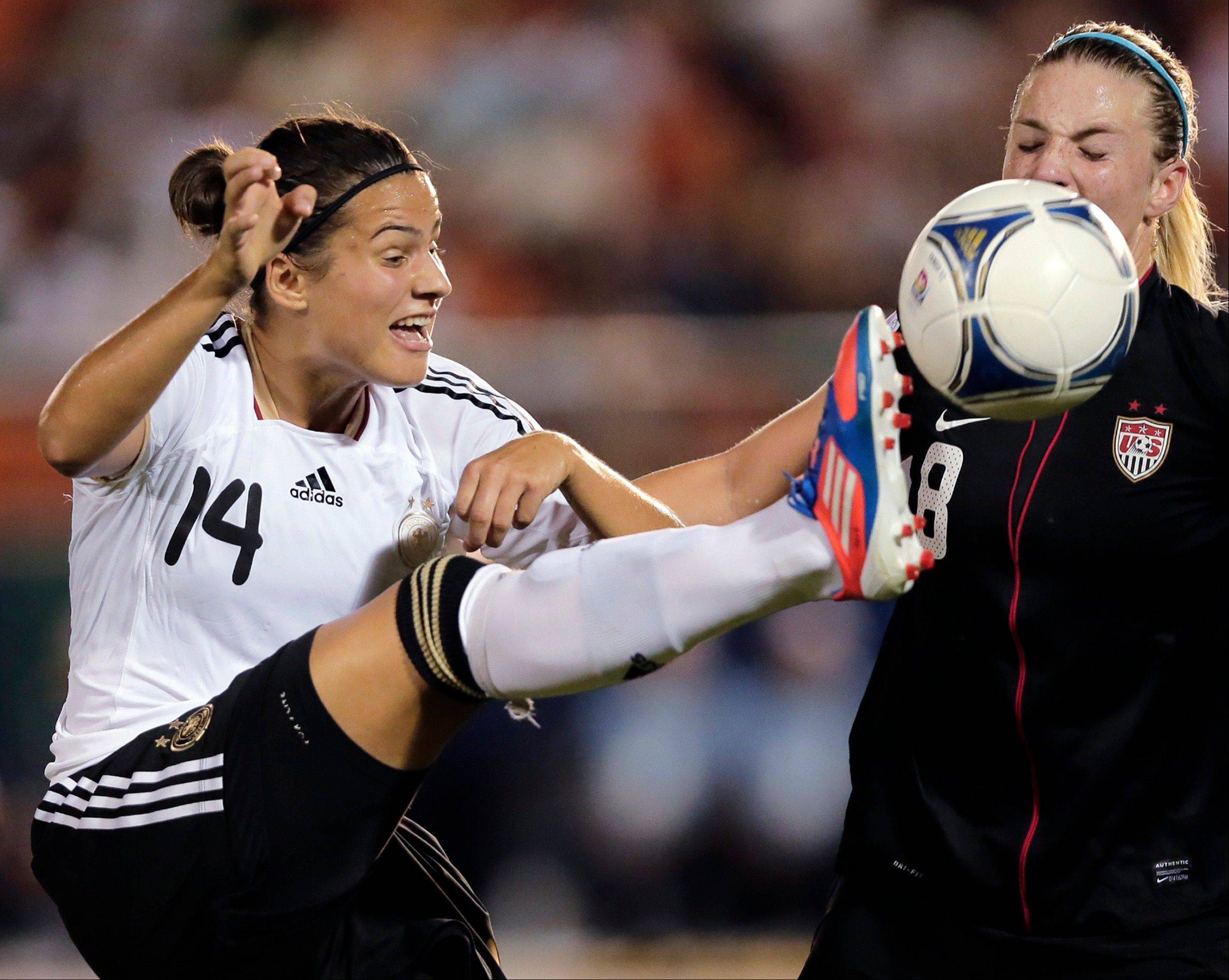 Dzsenifer Marozsan (14) of Germany and U.S. captain Julie Johnston (8) battle for the ball during their final match of the U20 women's World Cup Saturday in Tokyo.