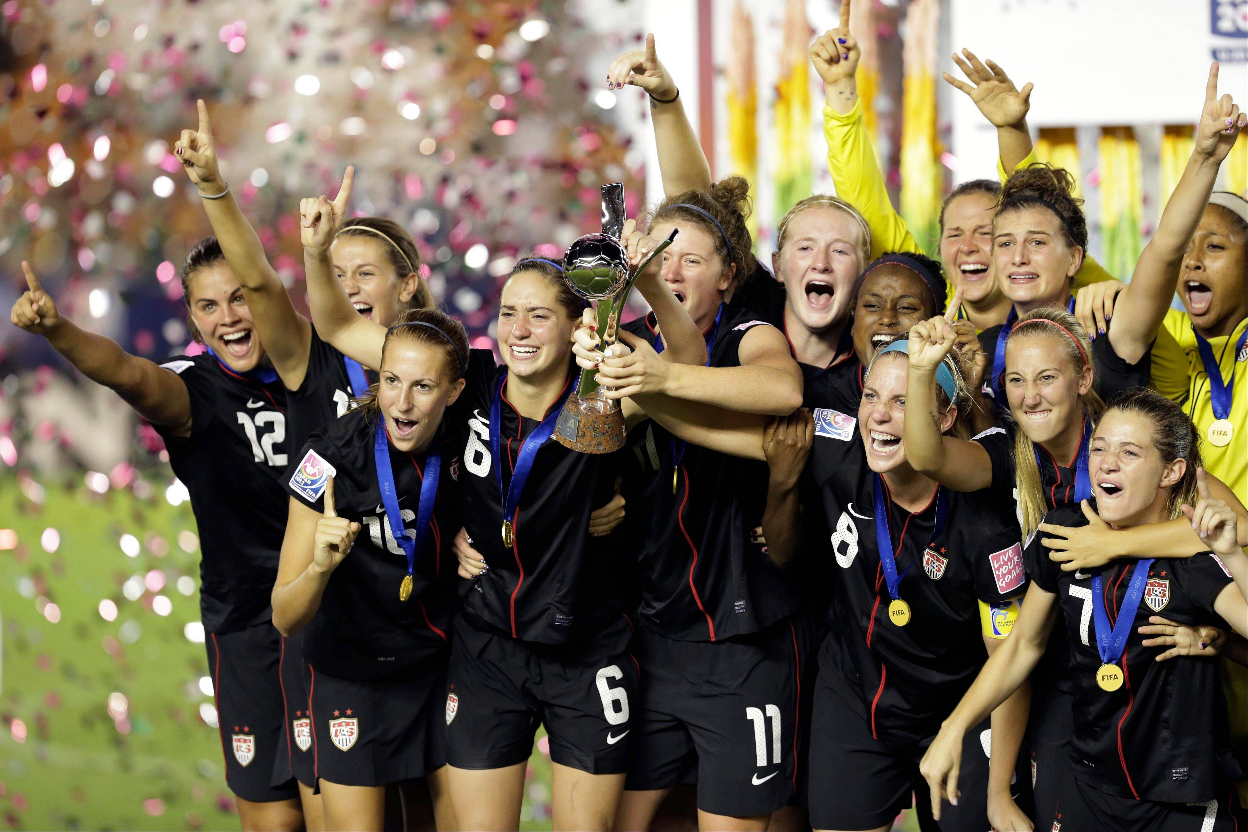 Players of the United States from left: Katie Stengel (12), Sarah Killion, Morgan Brian (6) and others celebrate winning the U20 Women's World Cup final in Tokyo, defeating Germany 1-0 Saturday.