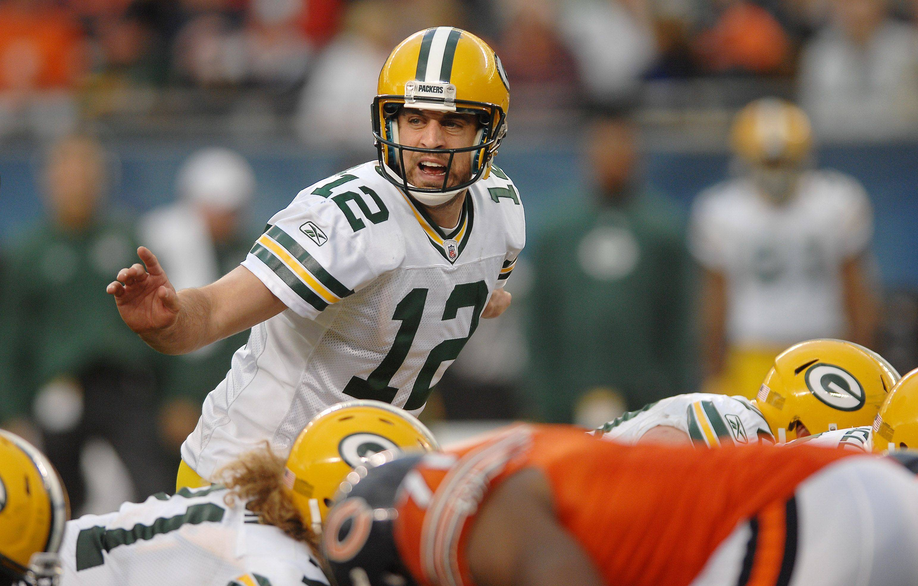 He still has a high-powered passing game, but Packers quarterback Aaron Rodgers can now hand the ball off to Cedric Benson.