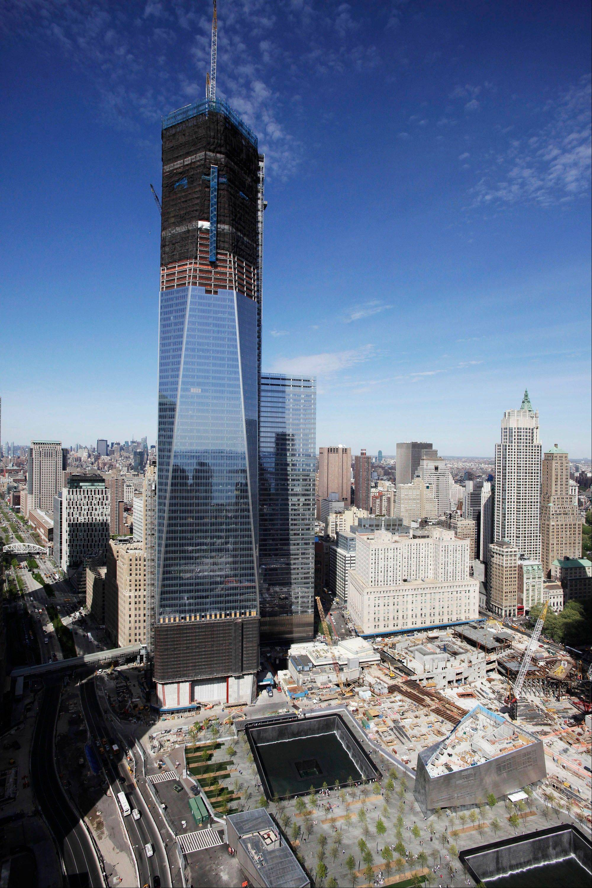 One World Trade Center rises above the lower Manhattan skyline and the National September 11 Memorial and Museum in New York. Eleven years after terrorists attacked the World Trade Center, the new World Trade Center now dominates the lower Manhattan skyline.