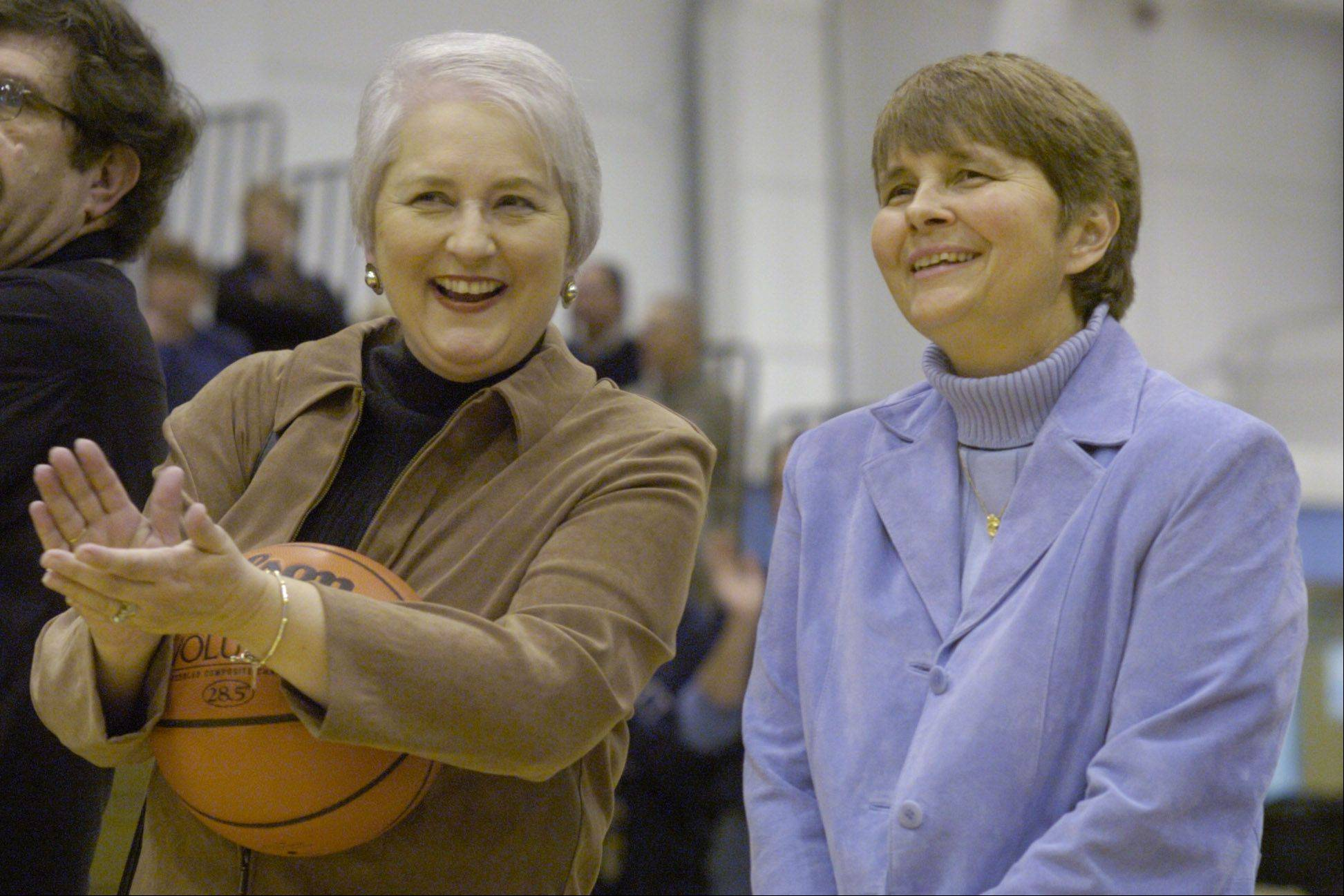 Jean Walker, right, is joined by her sister, Diane Carley, during a ceremony dedicating the Prospect field house in Walker's name in 2007.