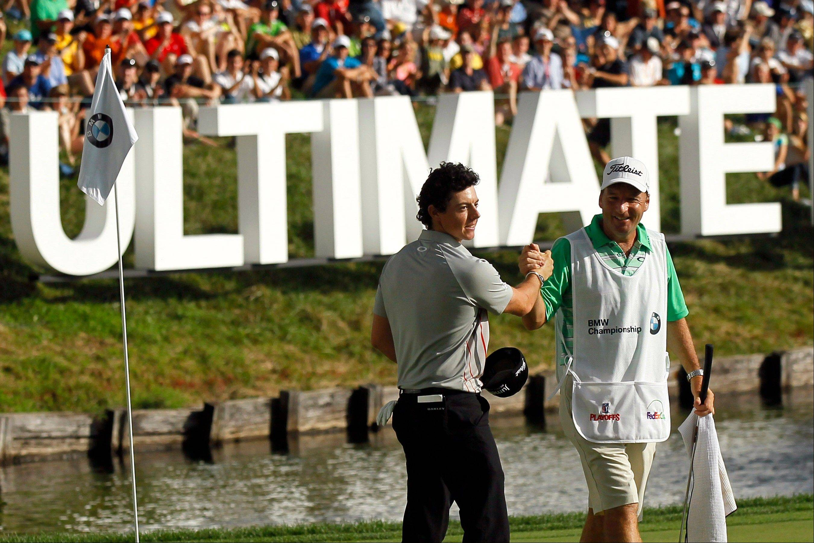 Rory McIlroy, left, of Northern Ireland, celebrates with caddie J.P. Fitzgerald after finishing the BMW Championship PGA golf tournament at Crooked Stick Golf Club in Carmel, Ind., Sunday, Sept. 9, 2012. McIlroy won the event. (AP Photo/Charles Rex Arbogast)