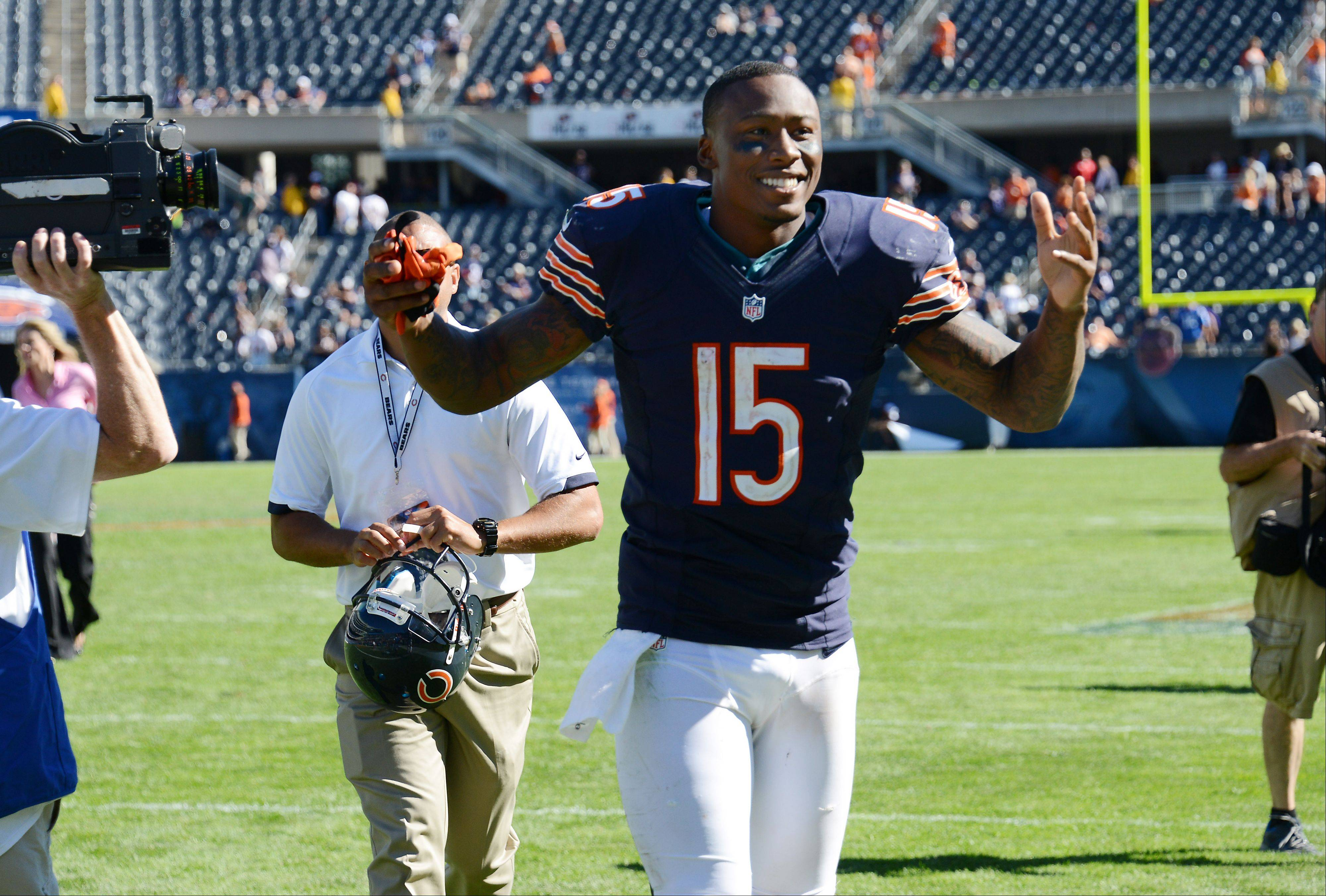 Bears wide receiver Brandon Marshall celebrates Sunday's season-opening victory as he runs off the field.