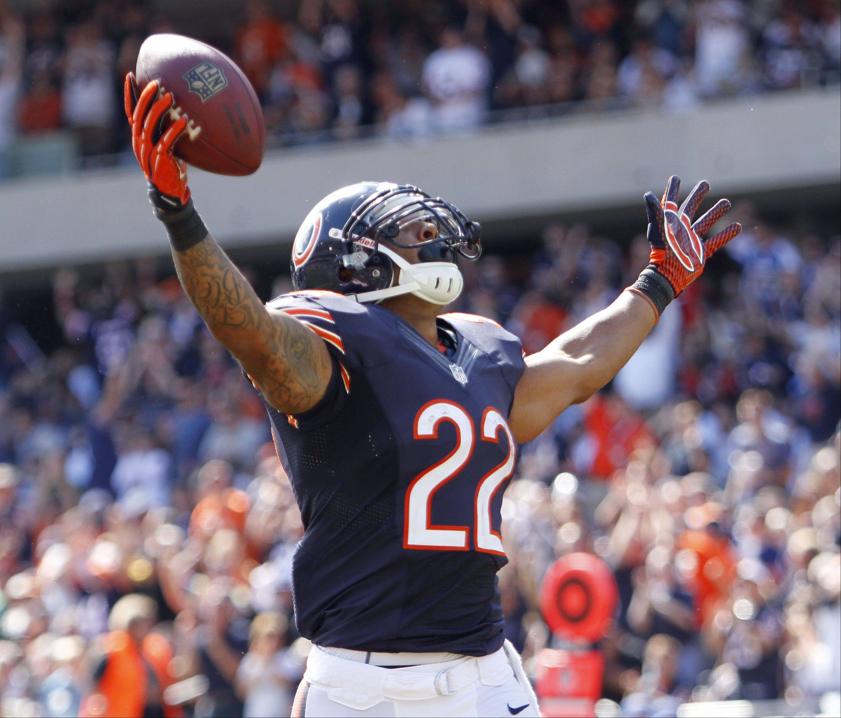 Chicago Bears running back Matt Forte celebrates after his 3rd quarter touchdown during the Bears season opener against the Indianapolis Colts Sunday at Soldier Field in Chicago. The Bears won 41-21