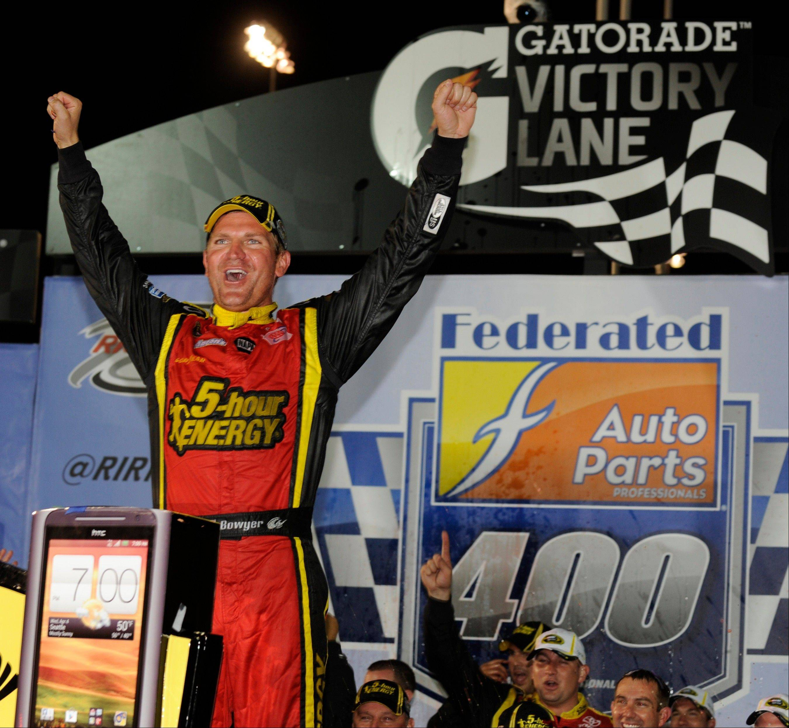 Clint Bowyer celebrates winning the NASCAR Sprint Cup Series auto race at Richmond International Raceway in Richmond, Va., Saturday, Sept. 8, 2012.