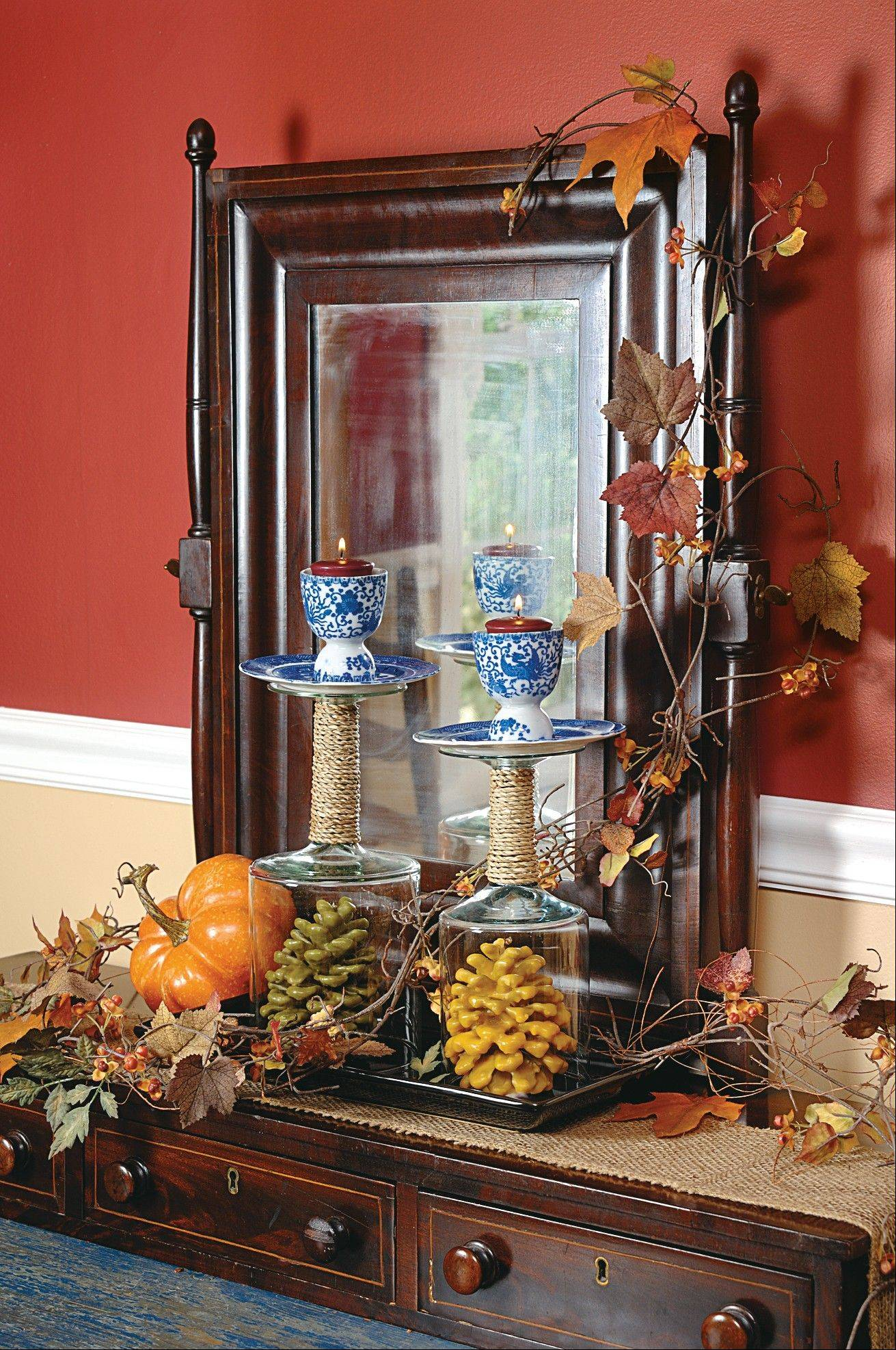 A shaving mirror is adorned with simple garland and a pumpking for a fall touch-up.